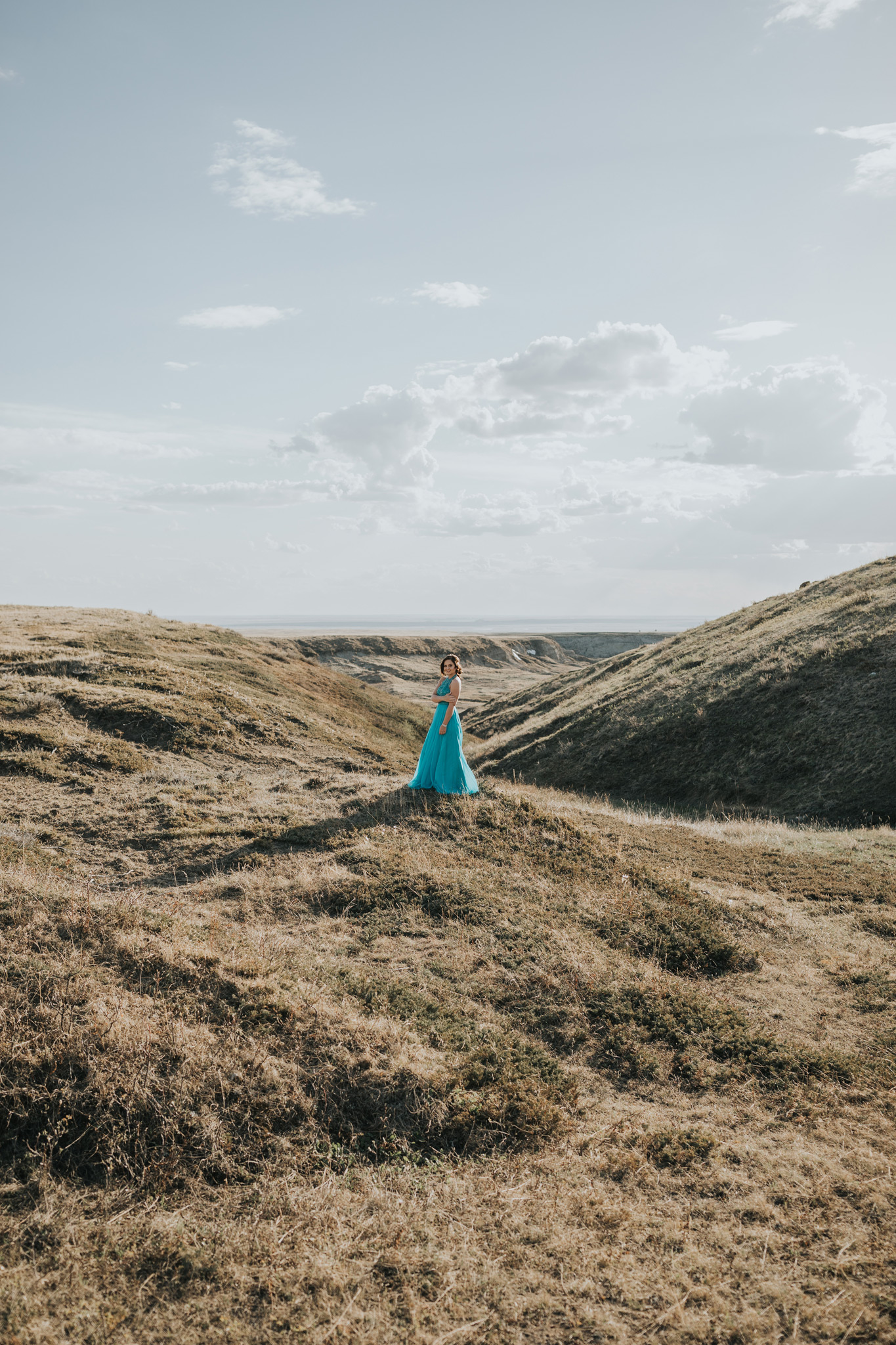 girl standing in grad dress smiling coulee