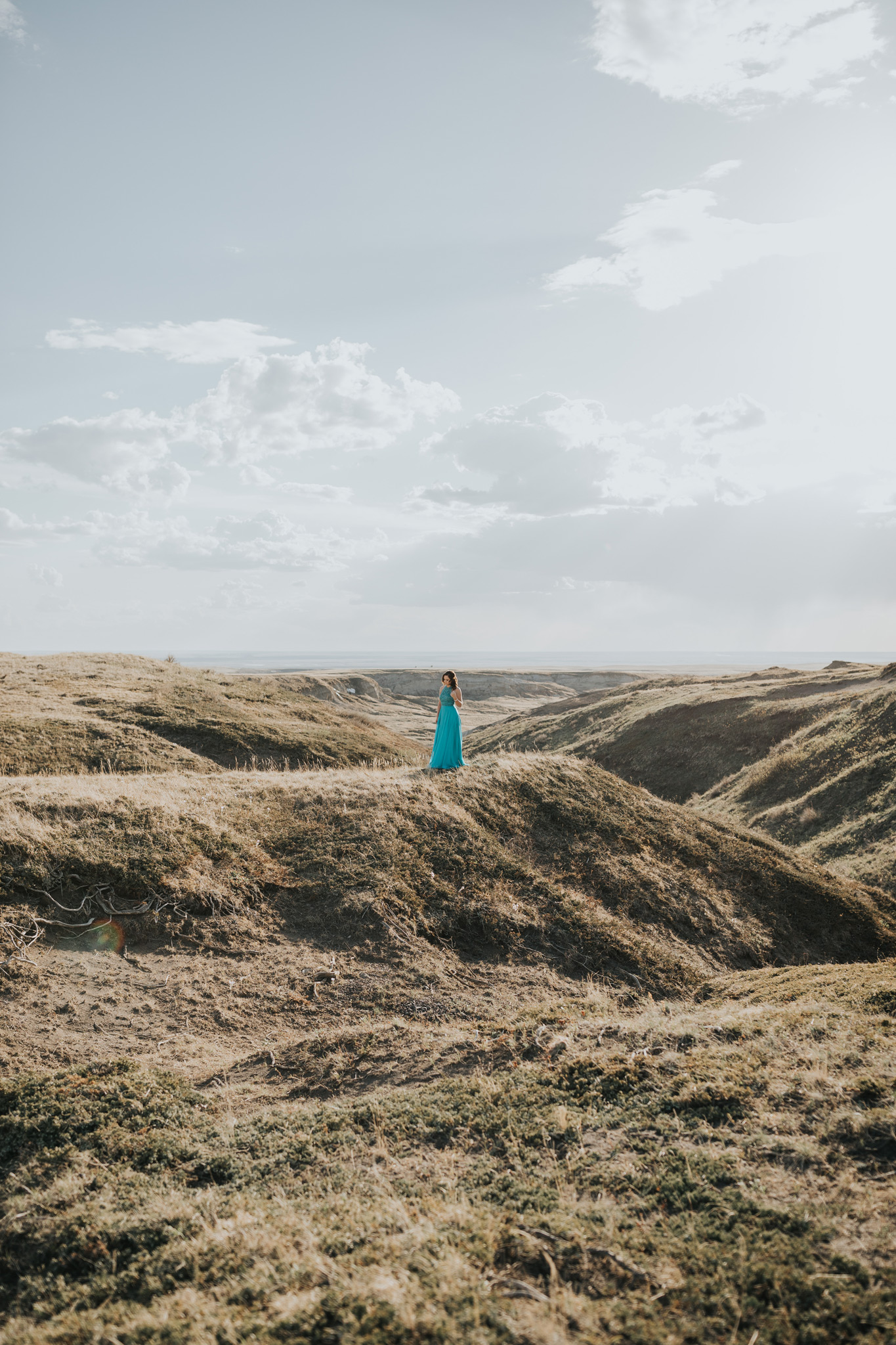 girl standing in prom dress landscape