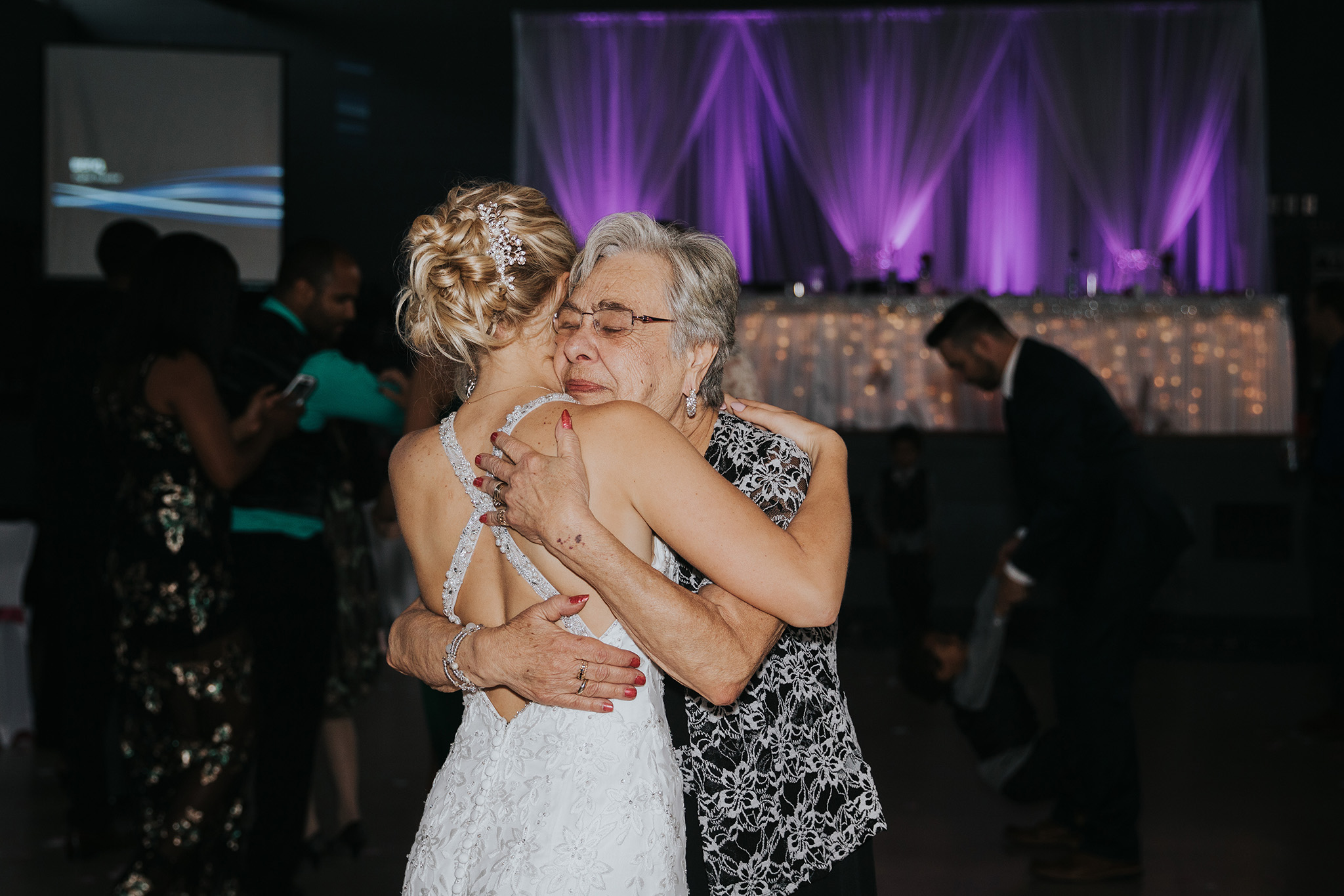 emotional grandma hugging bride