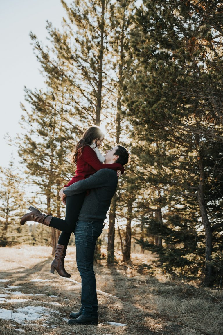 engaged couple girl being lifted up foot pop elkwater