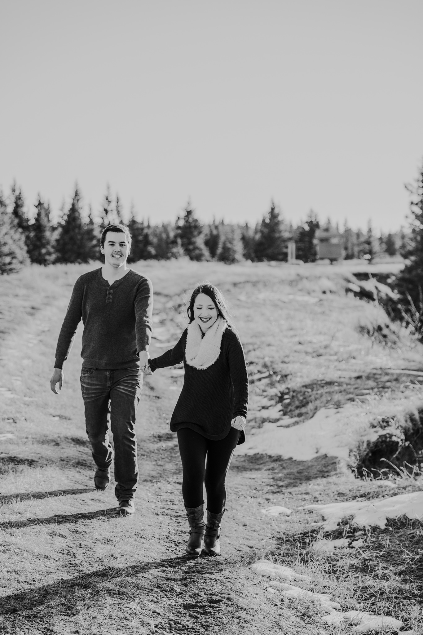 happy couple walking together horseshoe canyon alberta