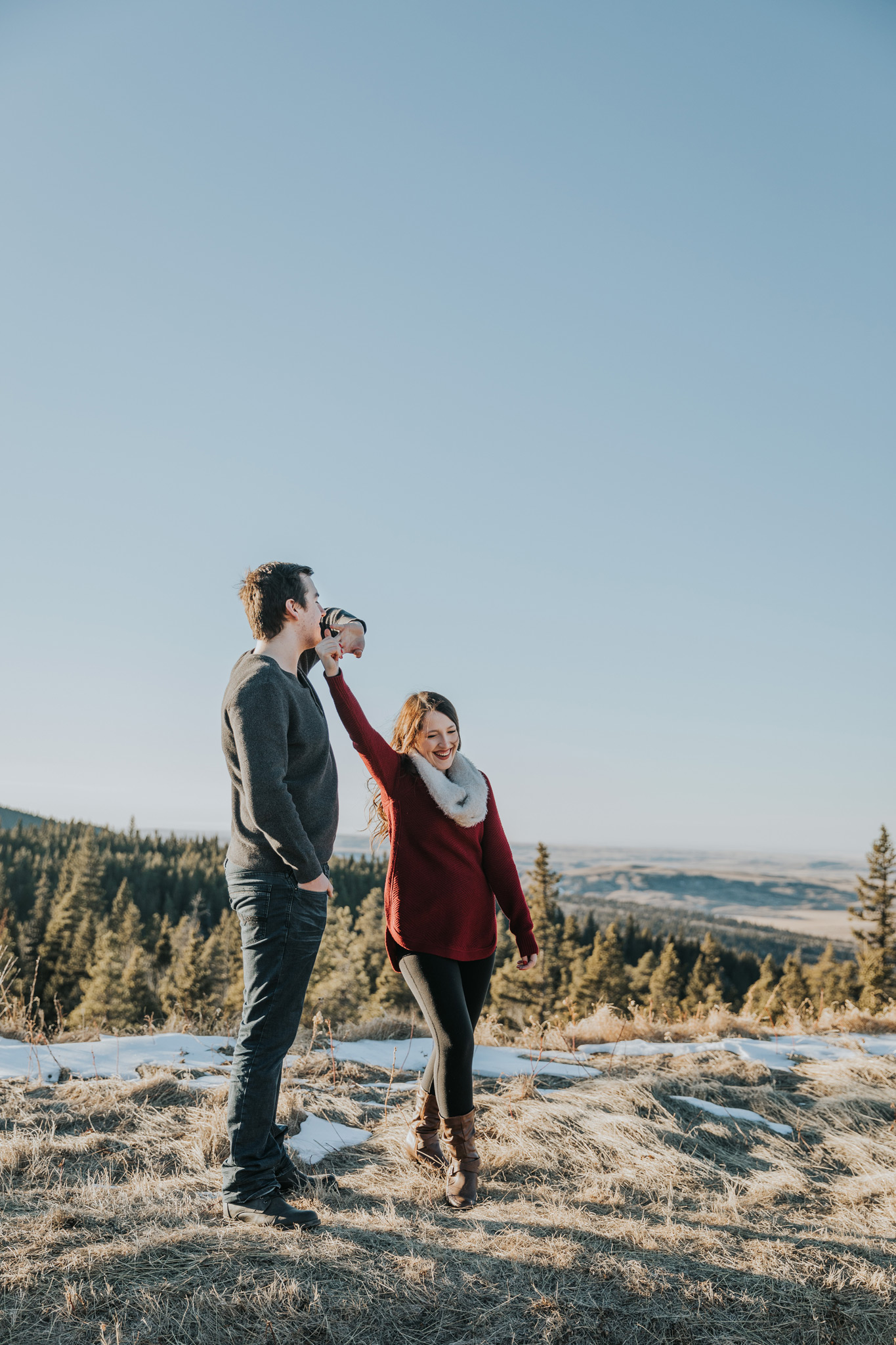 engaged couple dancing at horseshoe canyon lookout cypress hills