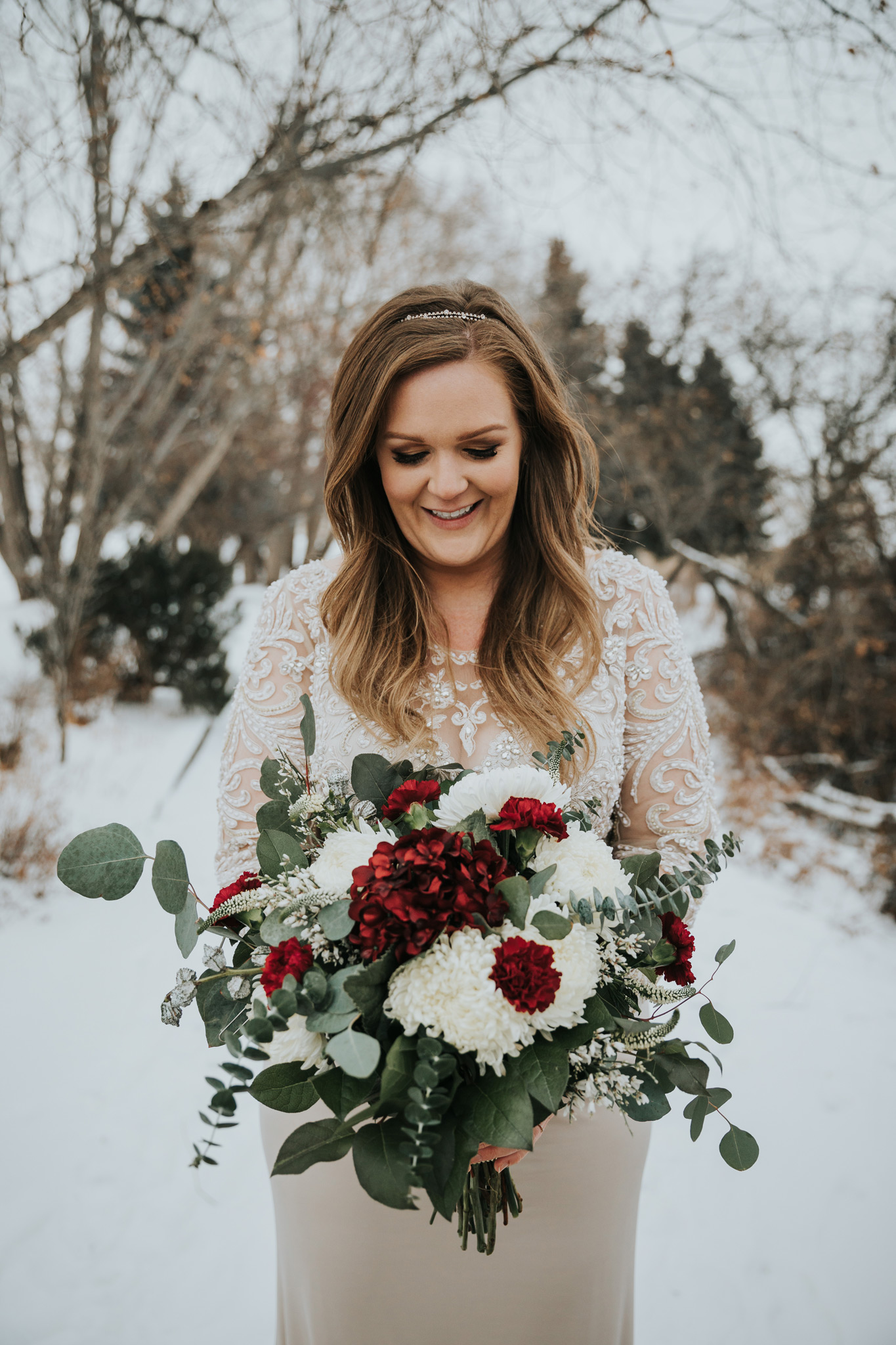 happy bride holding bouquet winter wedding alberta