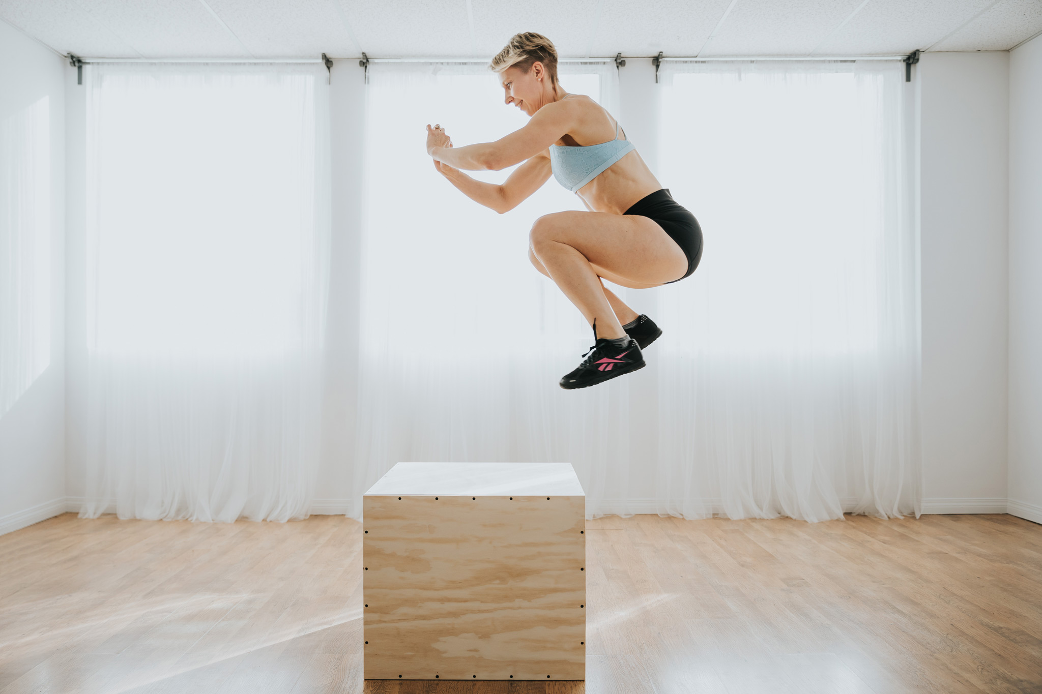 woman doing box jump workout