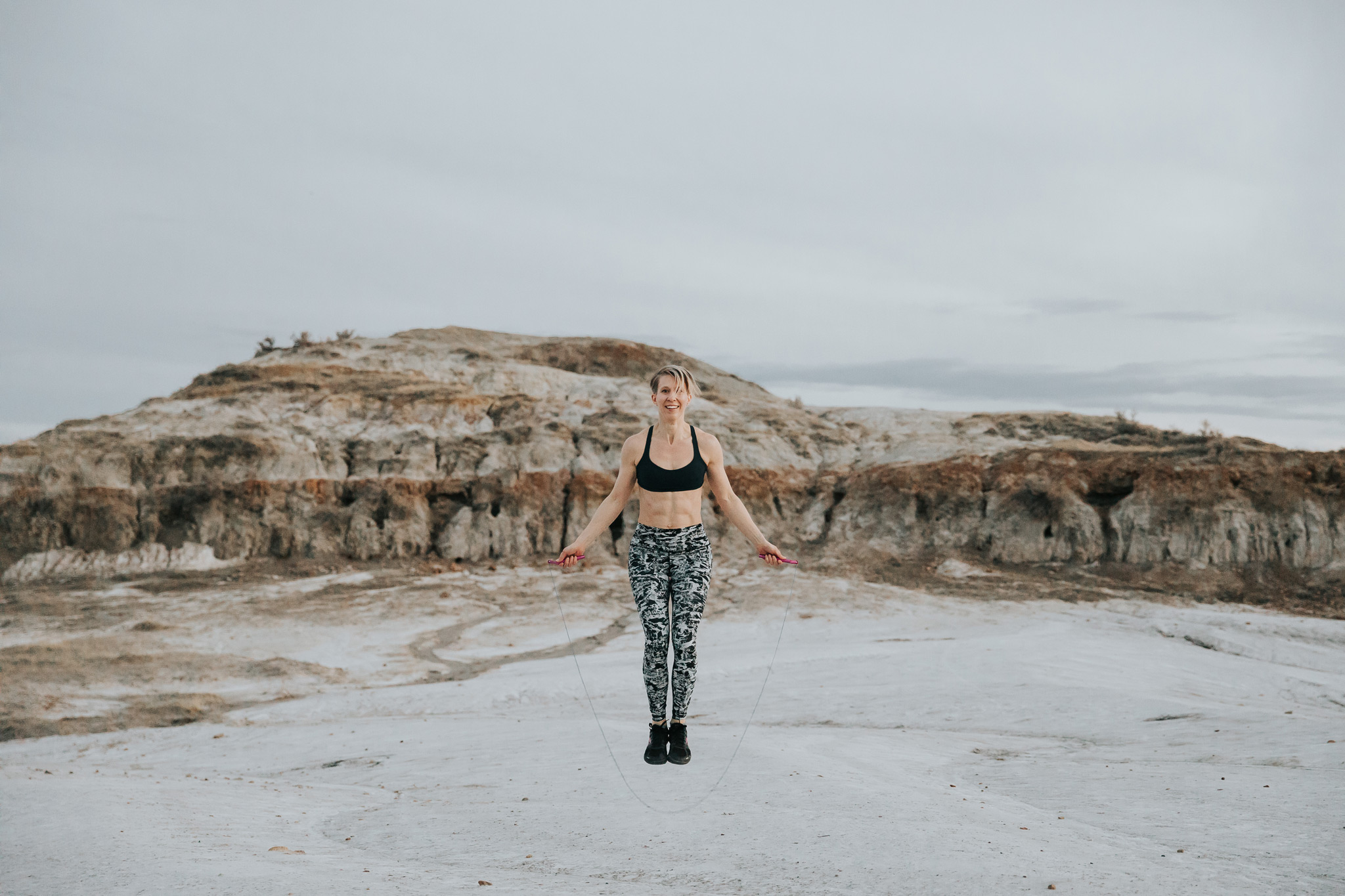 woman jumping rope outside clay pits