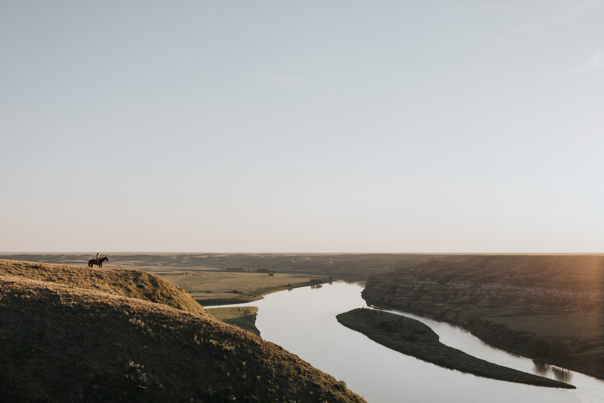 view of coulees river and girl on horse