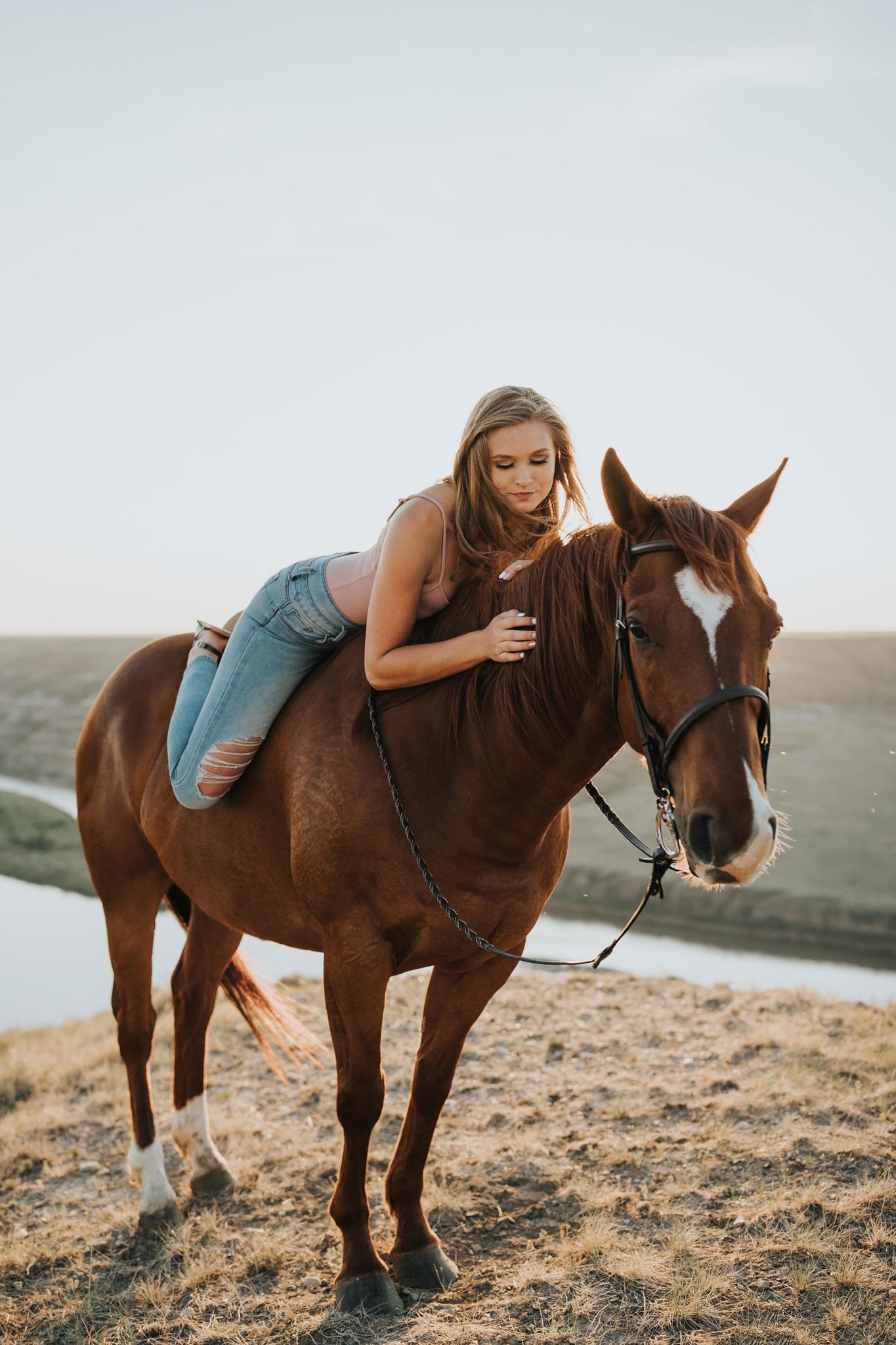 senior photo laying on horse