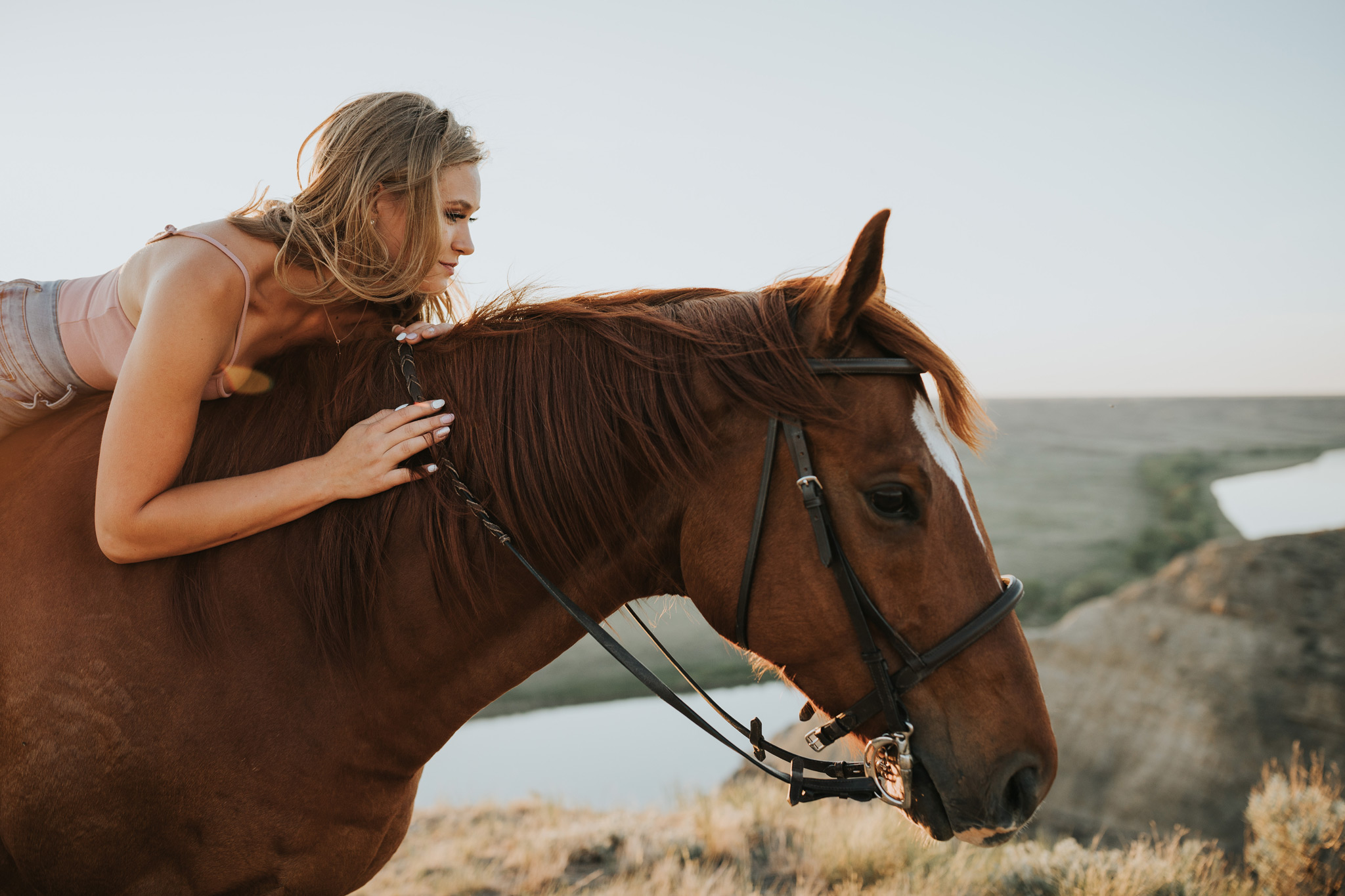 equine session girl laying on horse