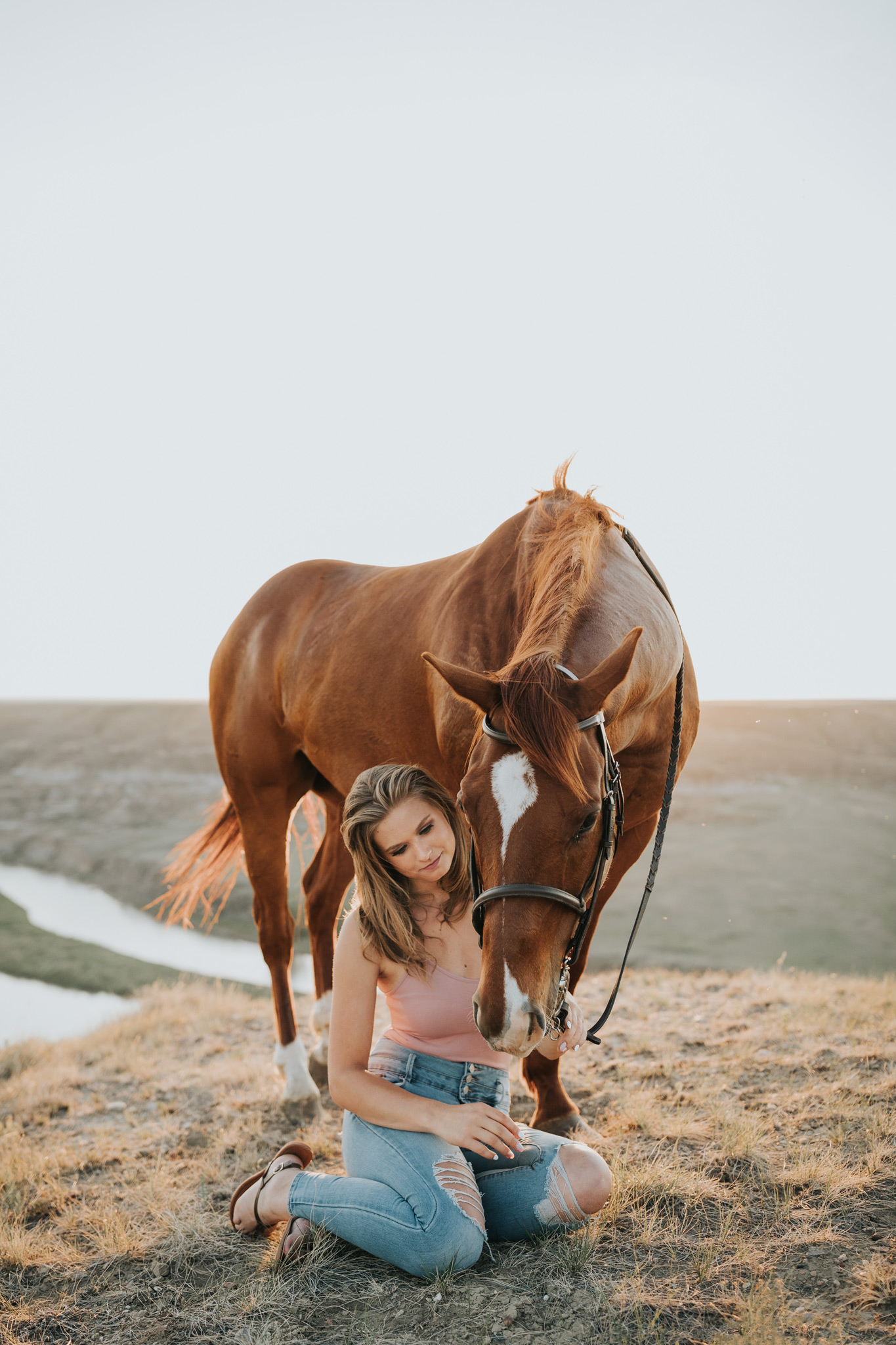 girl sits beside horse equine photo