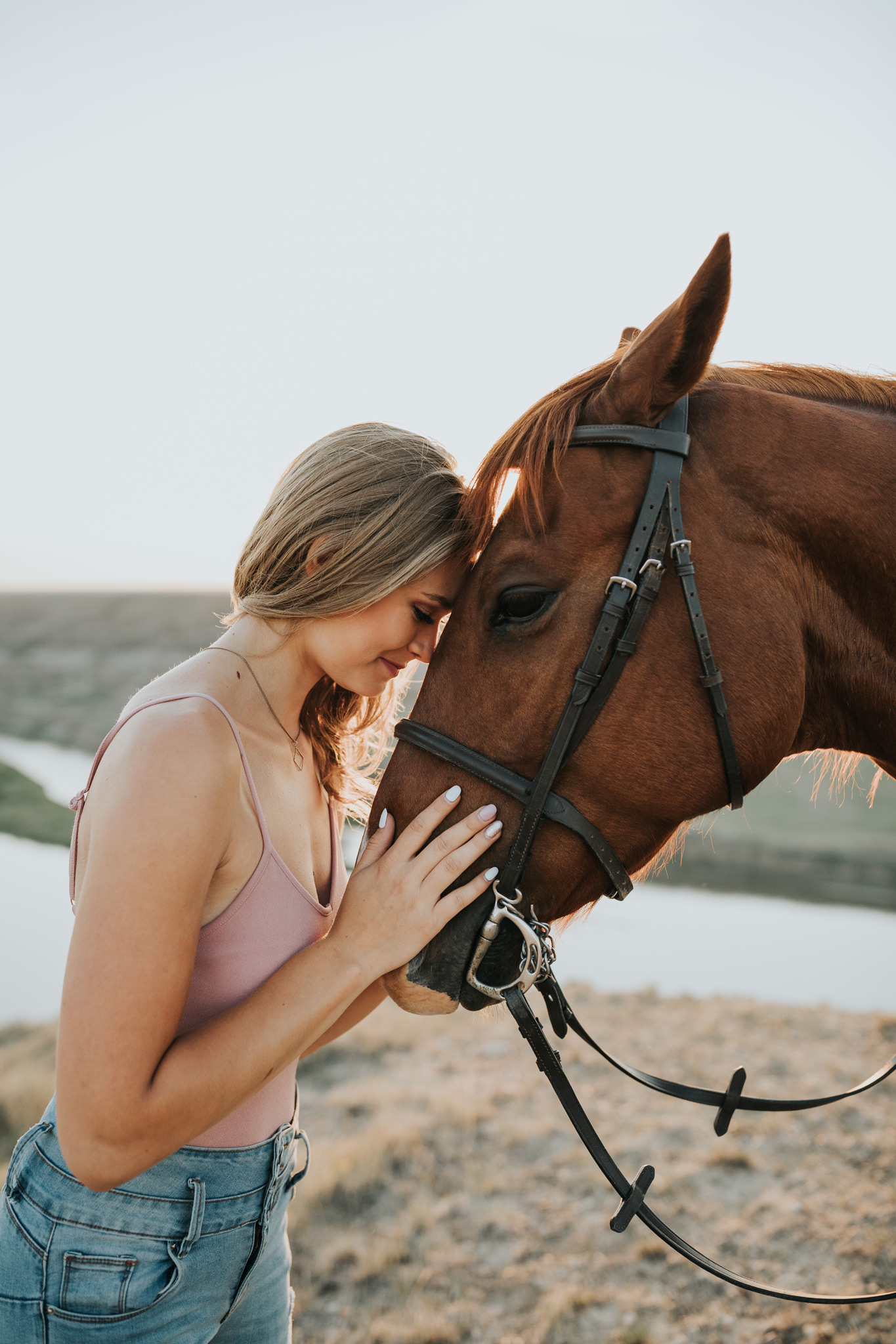 girl and horse touching foreheads
