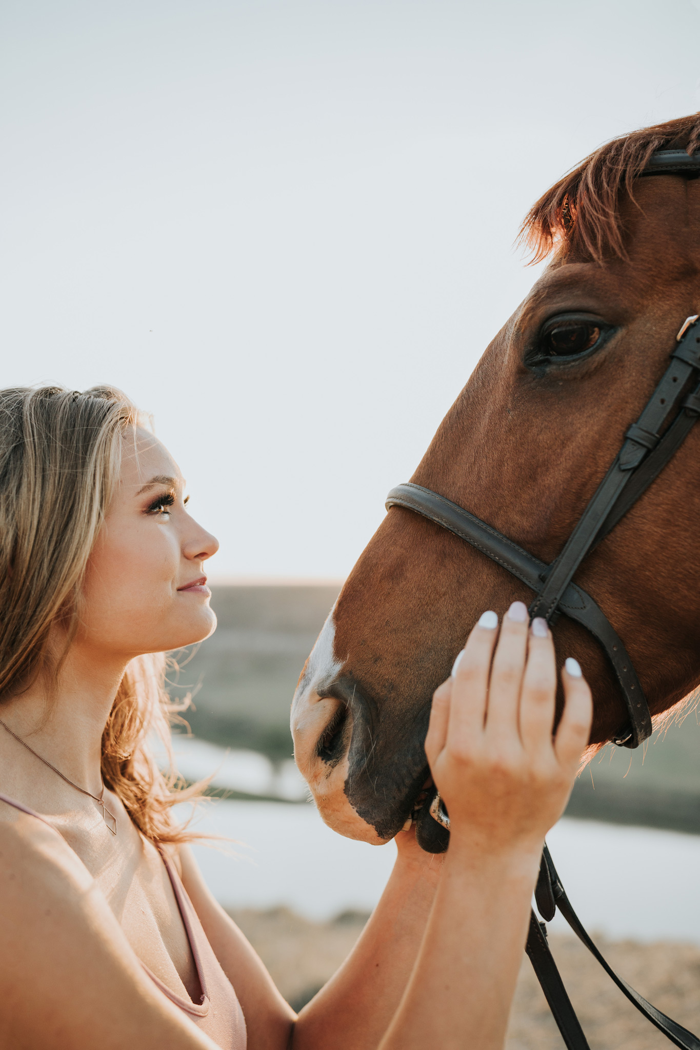 girl looking into horses eyes