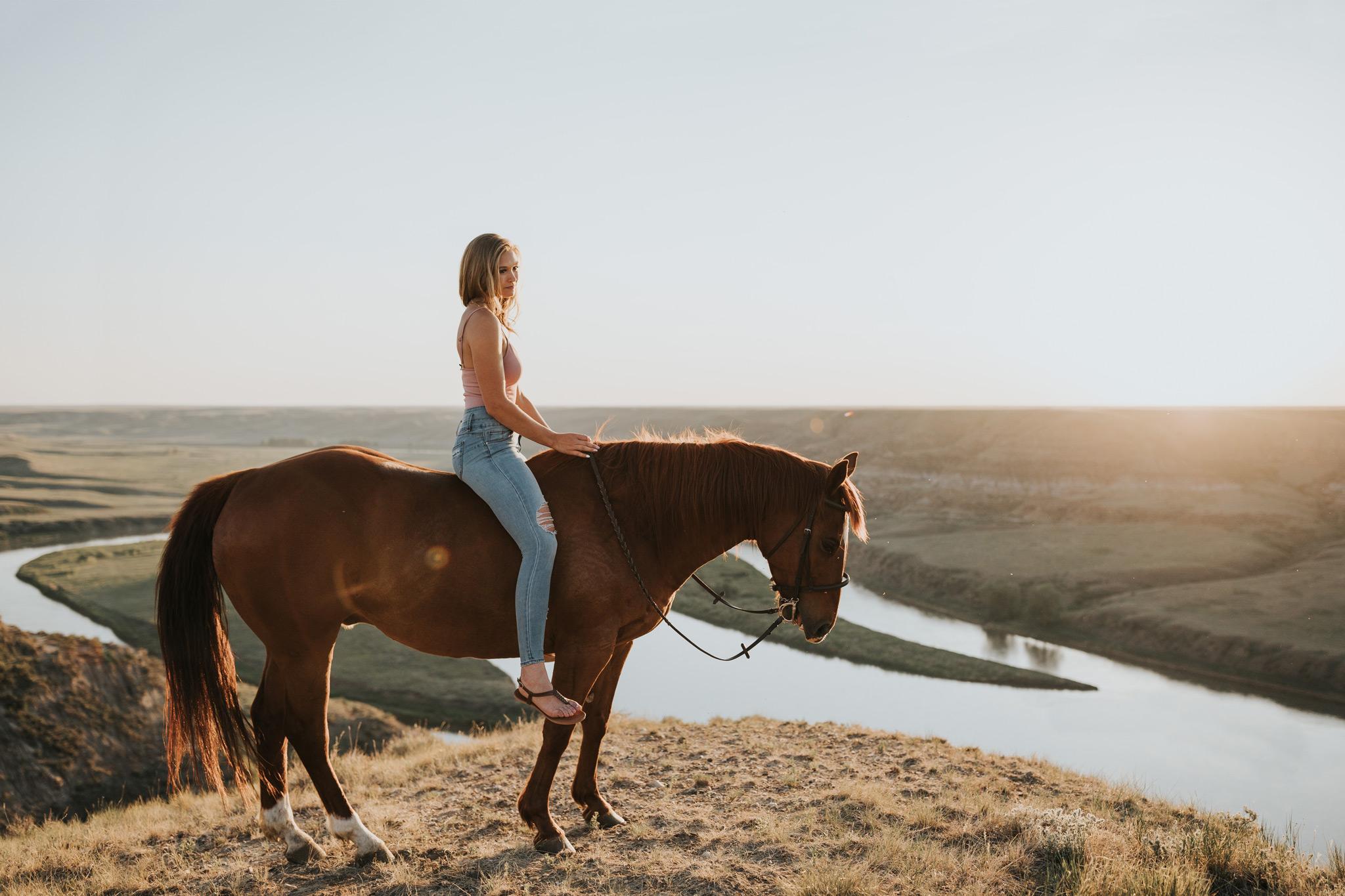 girl riding horse sunset lens flare