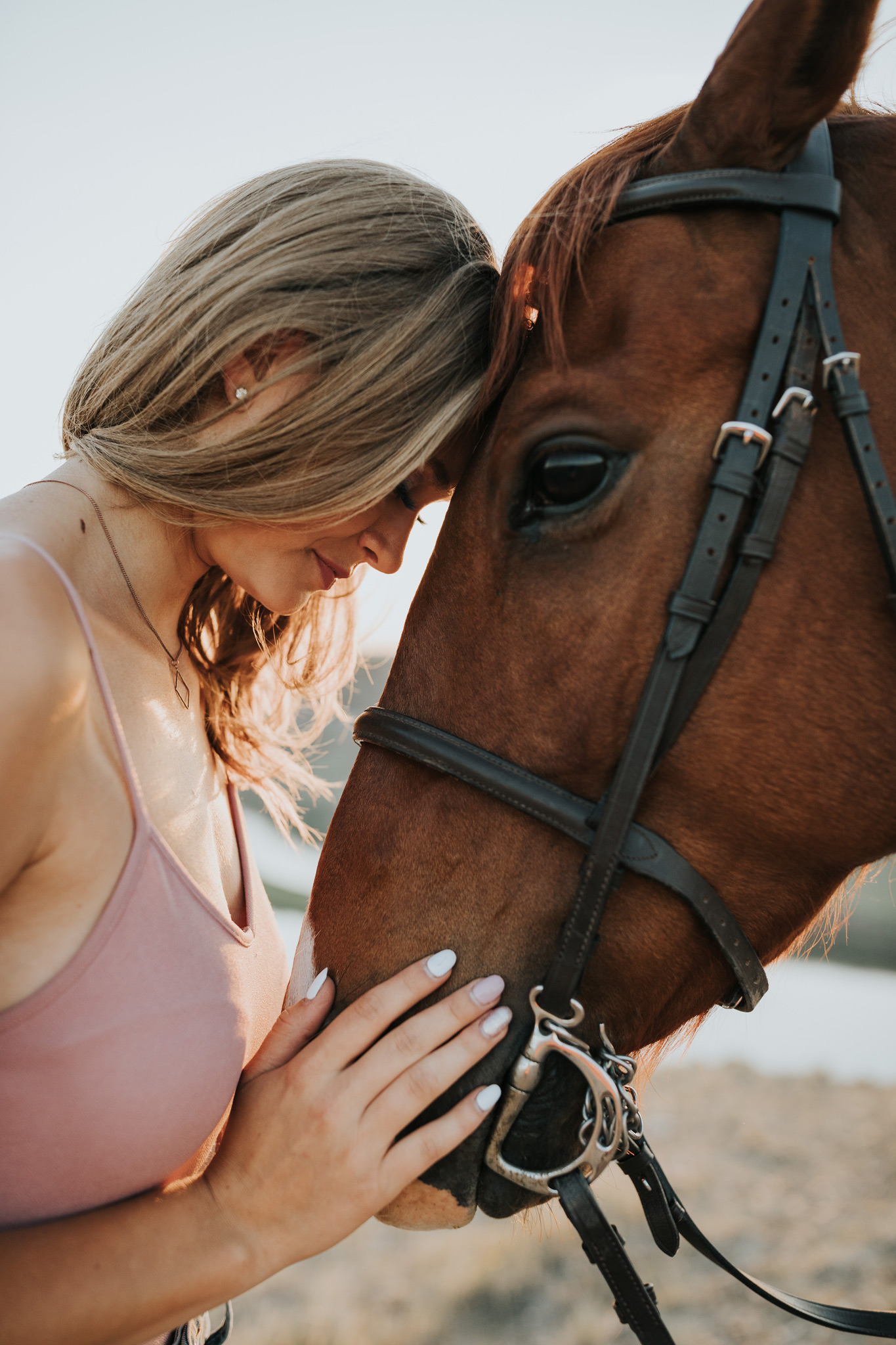 girl and horse touching foreheads equine photo