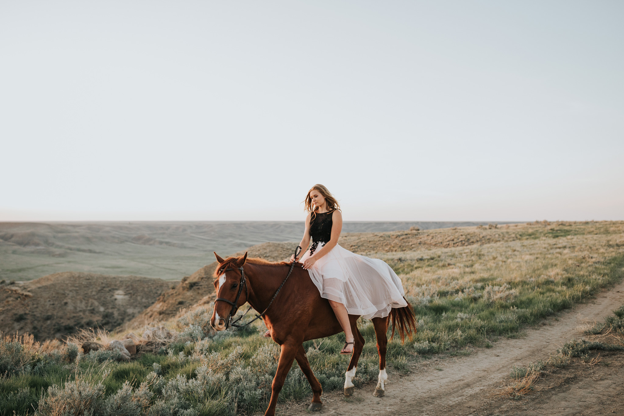 girl in grad dress riding horse