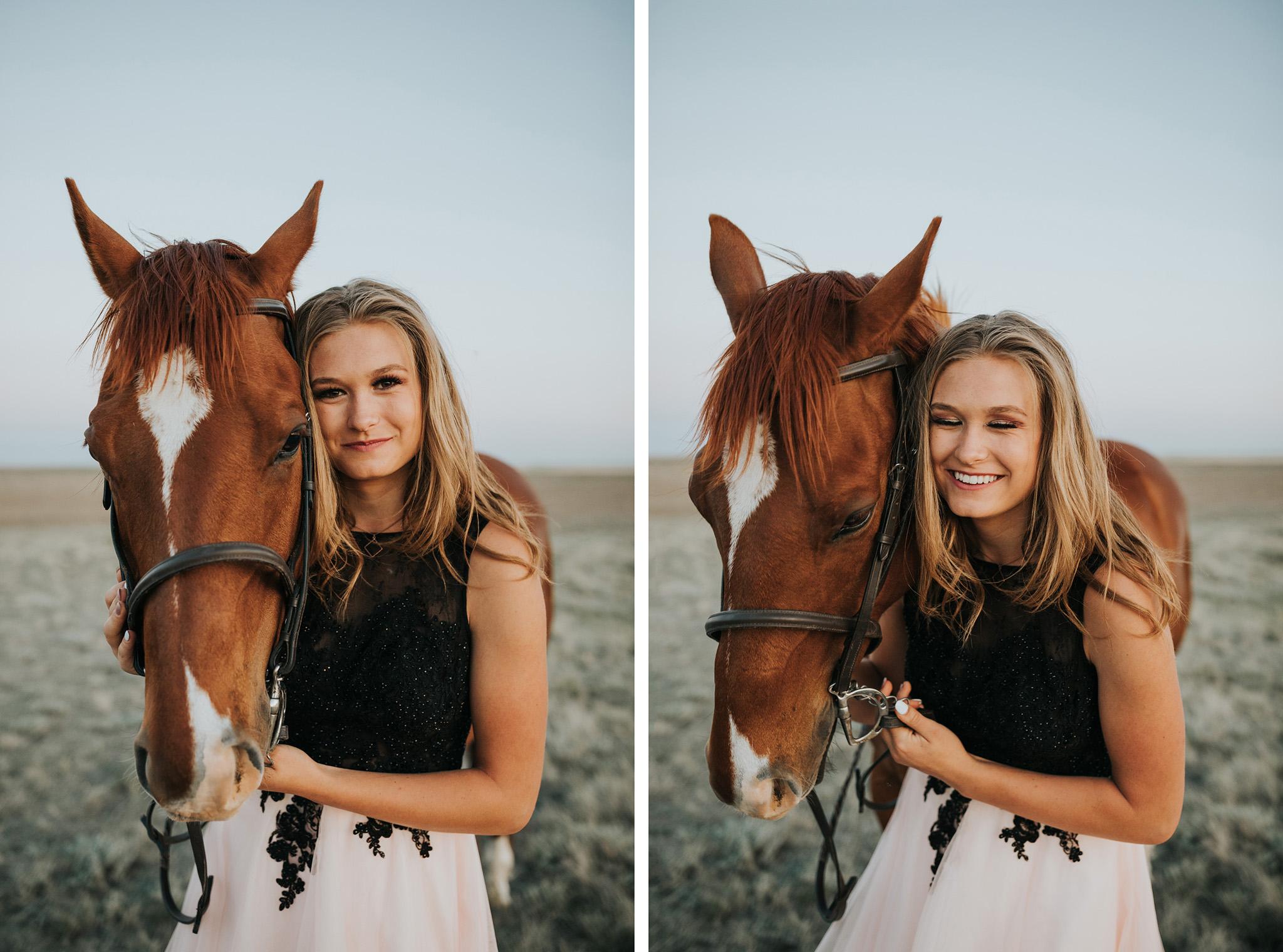 senior girl standing beside horse smiling laughing
