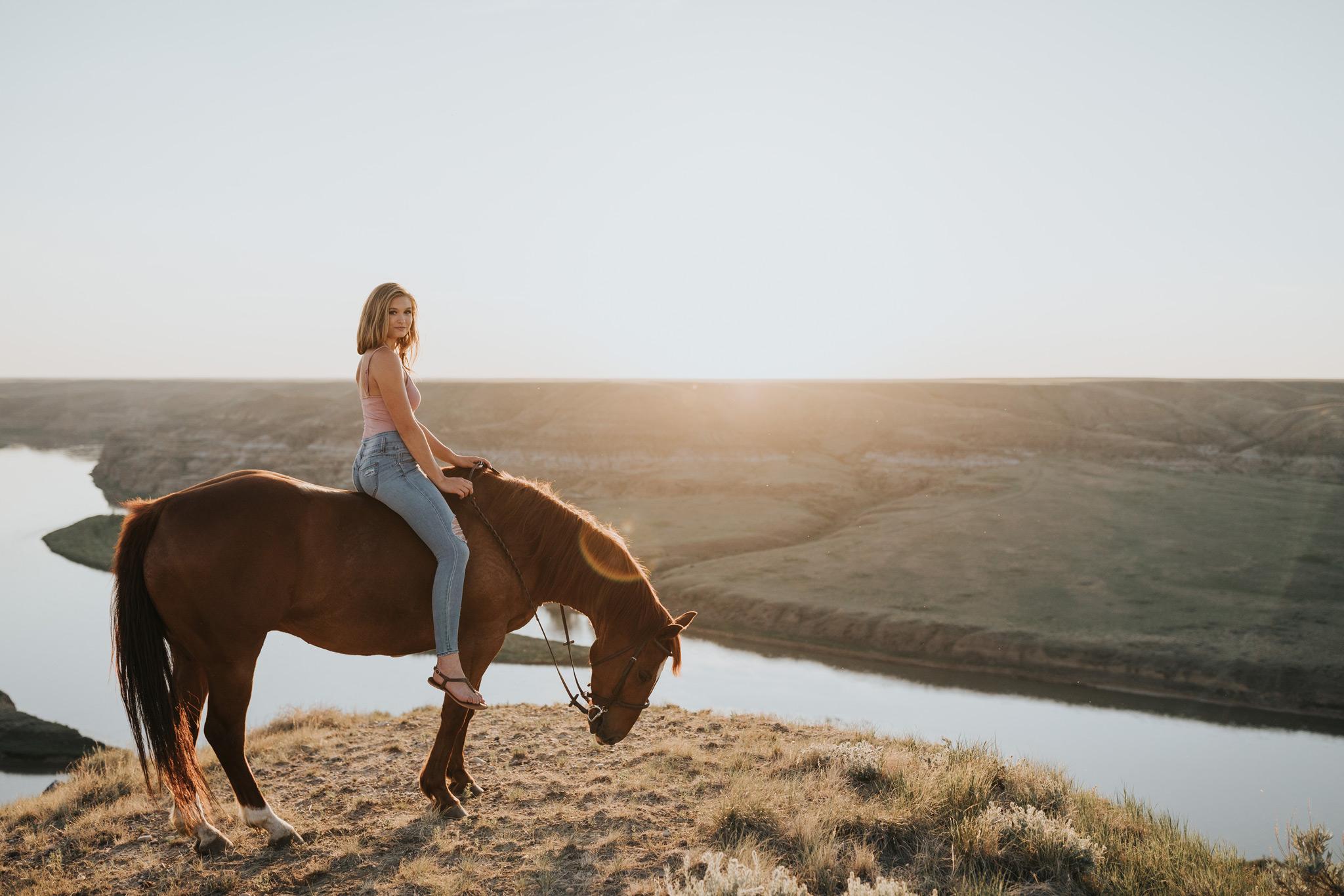 alberta sunset girl on horse lens flare