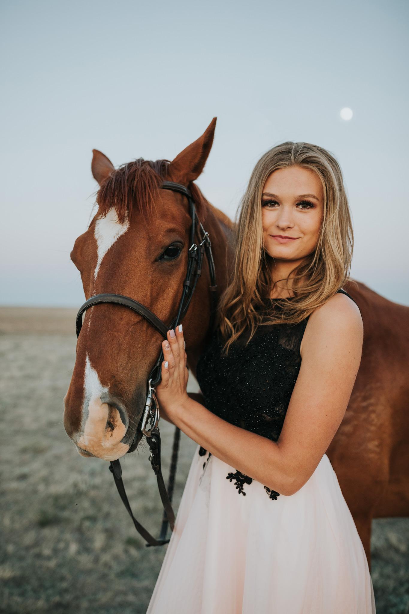 grad girl standing beside horse equine photo