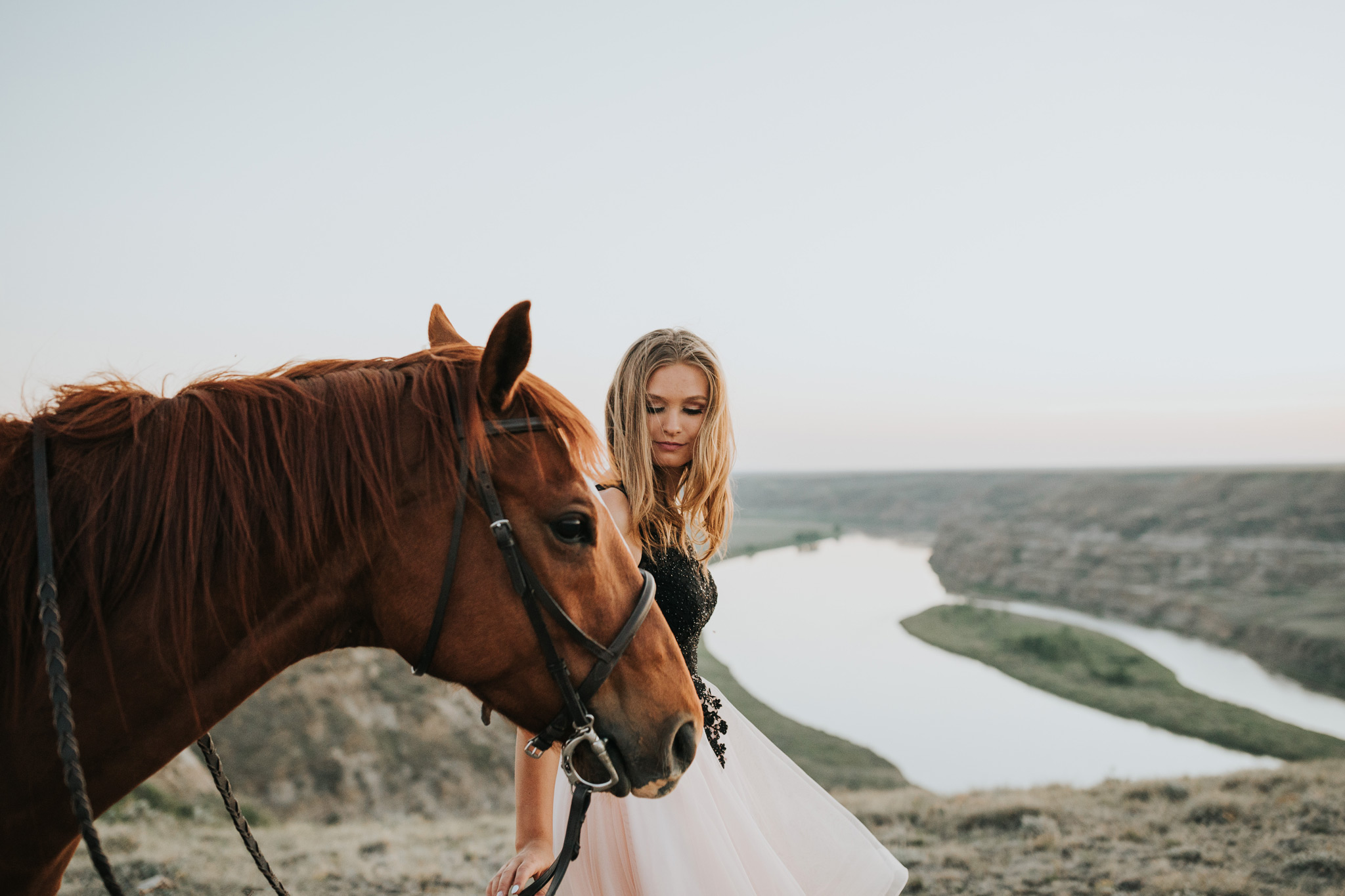 graduate girl walking horse view of coulee and river