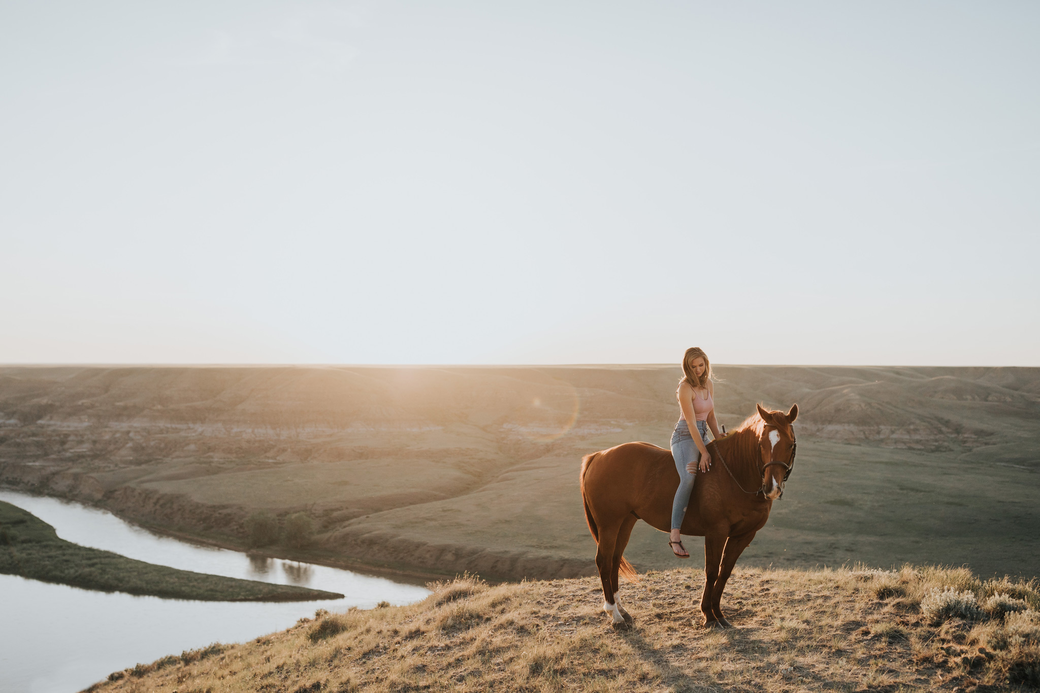 alberta farm coulee sunset girl sitting on horse