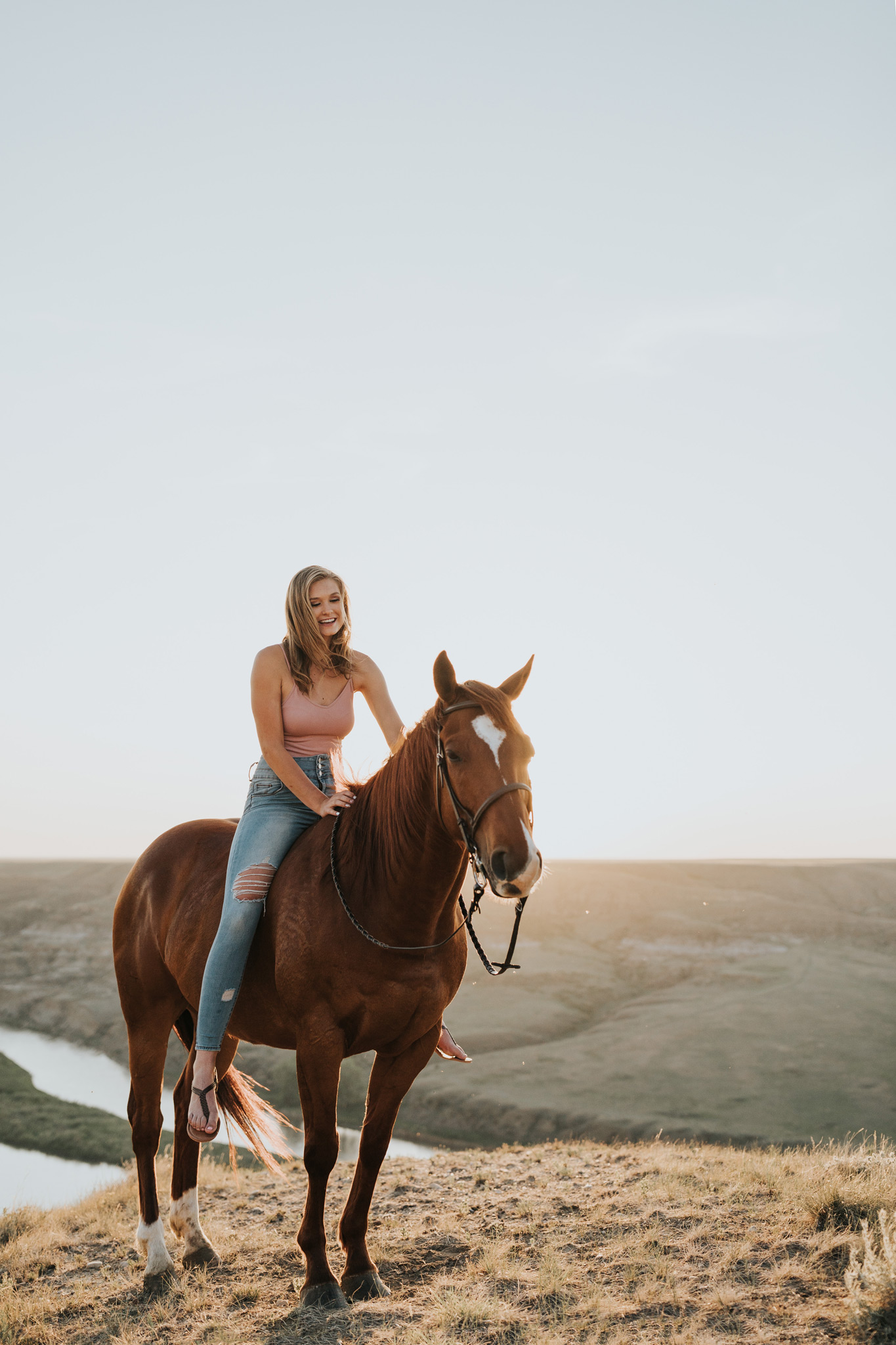 girl on horse laughing equestrian photo