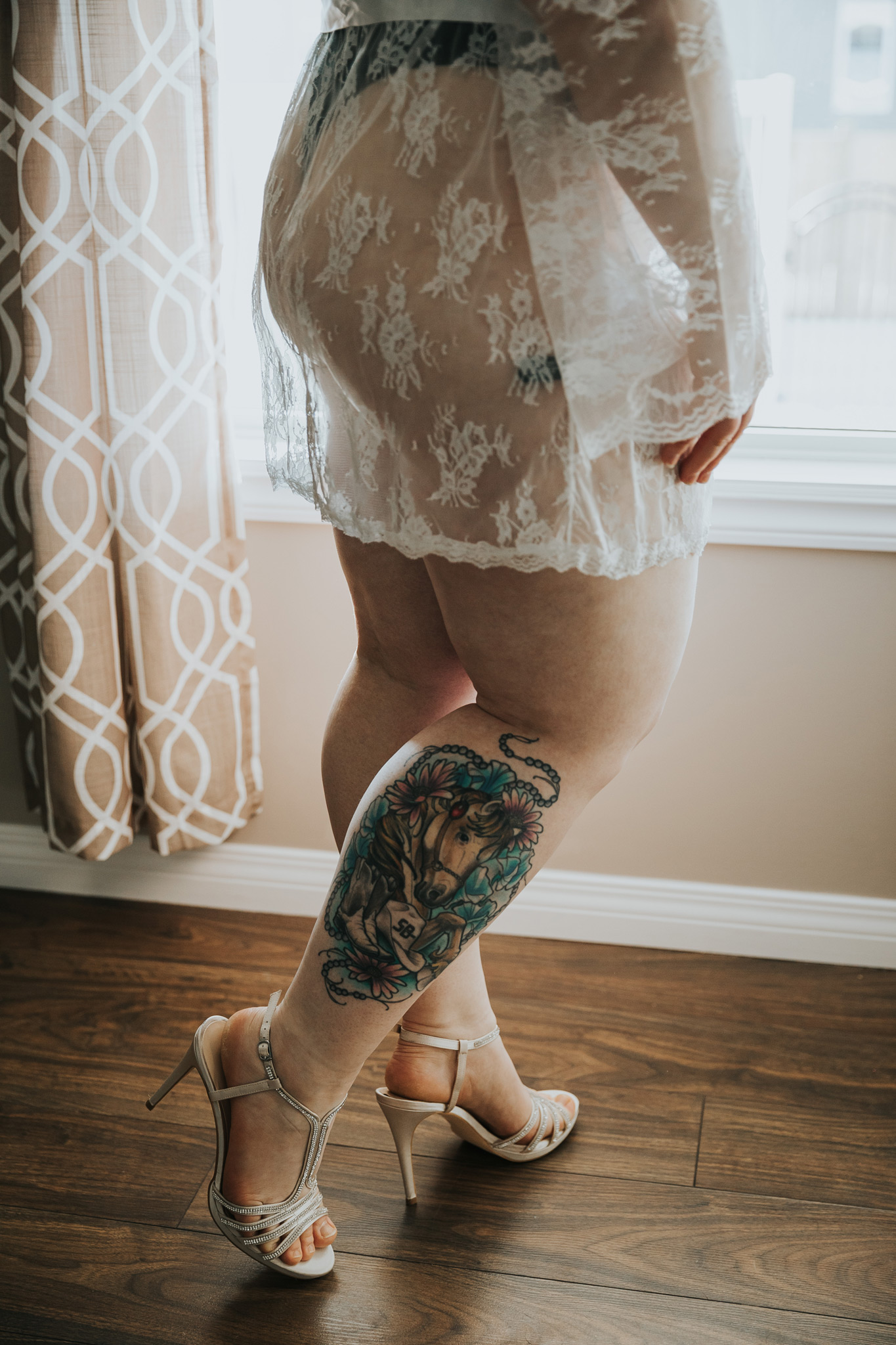 closeup of legs tattoo heels bridal boudoir