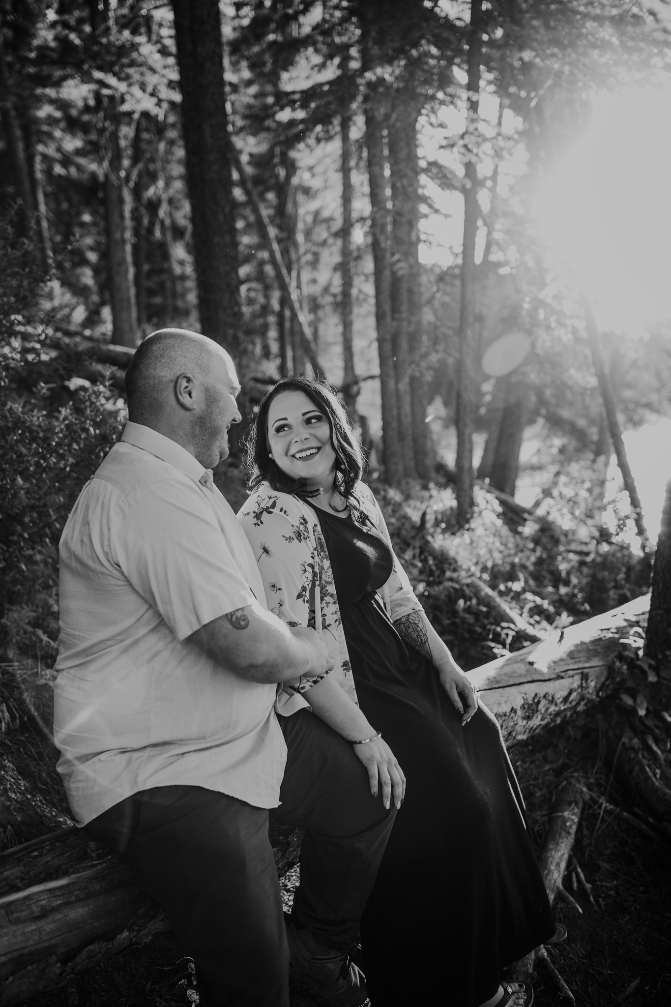 couple sitting on fallen tree cypress hills engagement photo