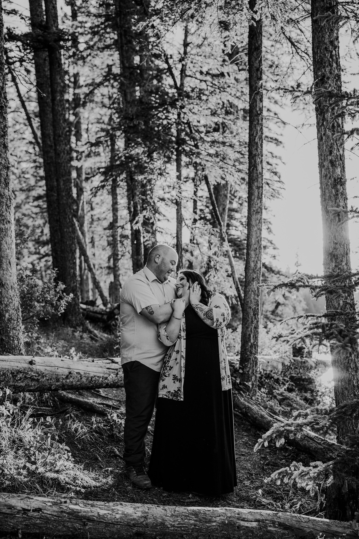 couple standing together in forest cypress hills engagement photo