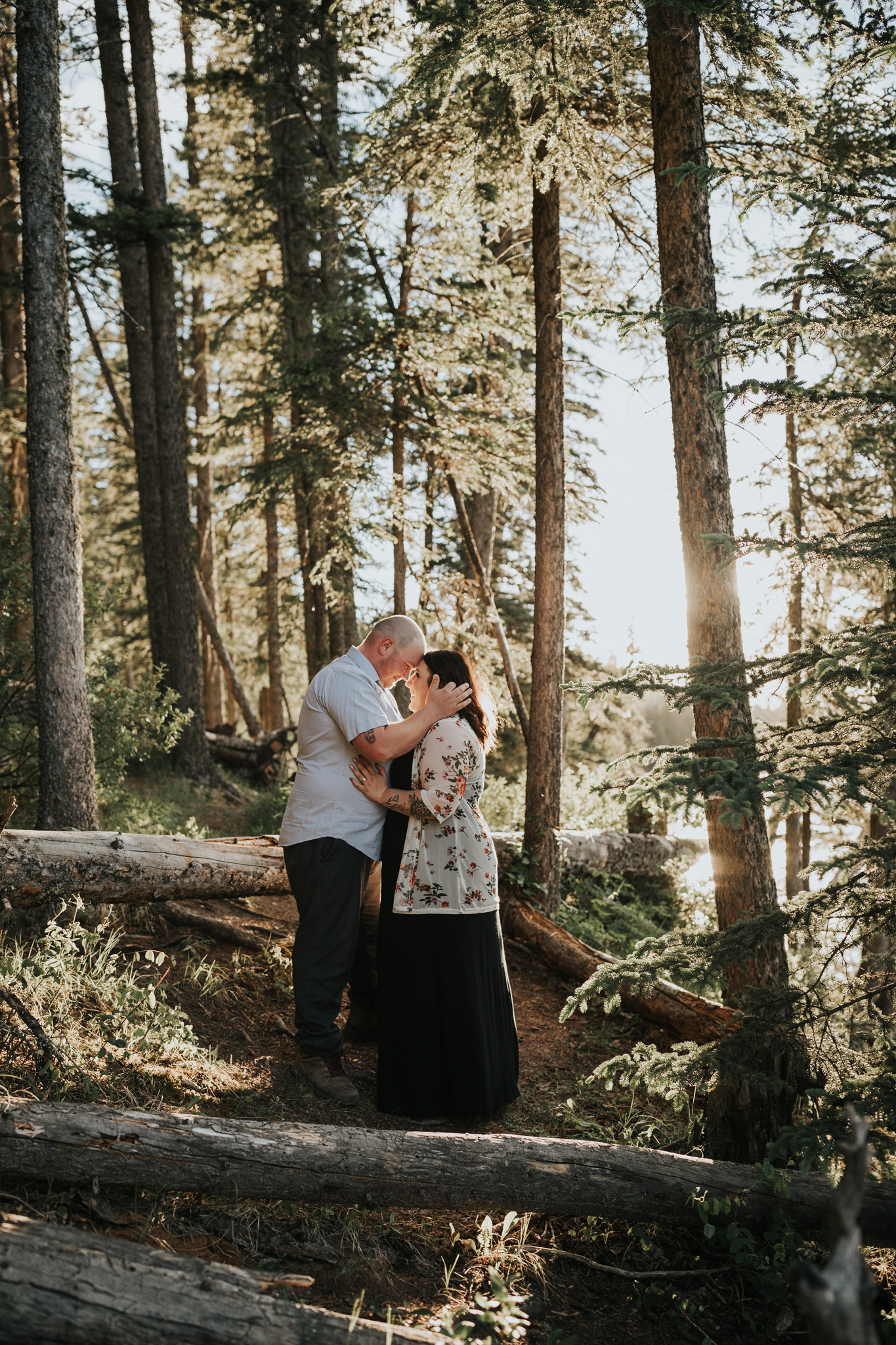 couple standing together in forest reesor lake engagement photo