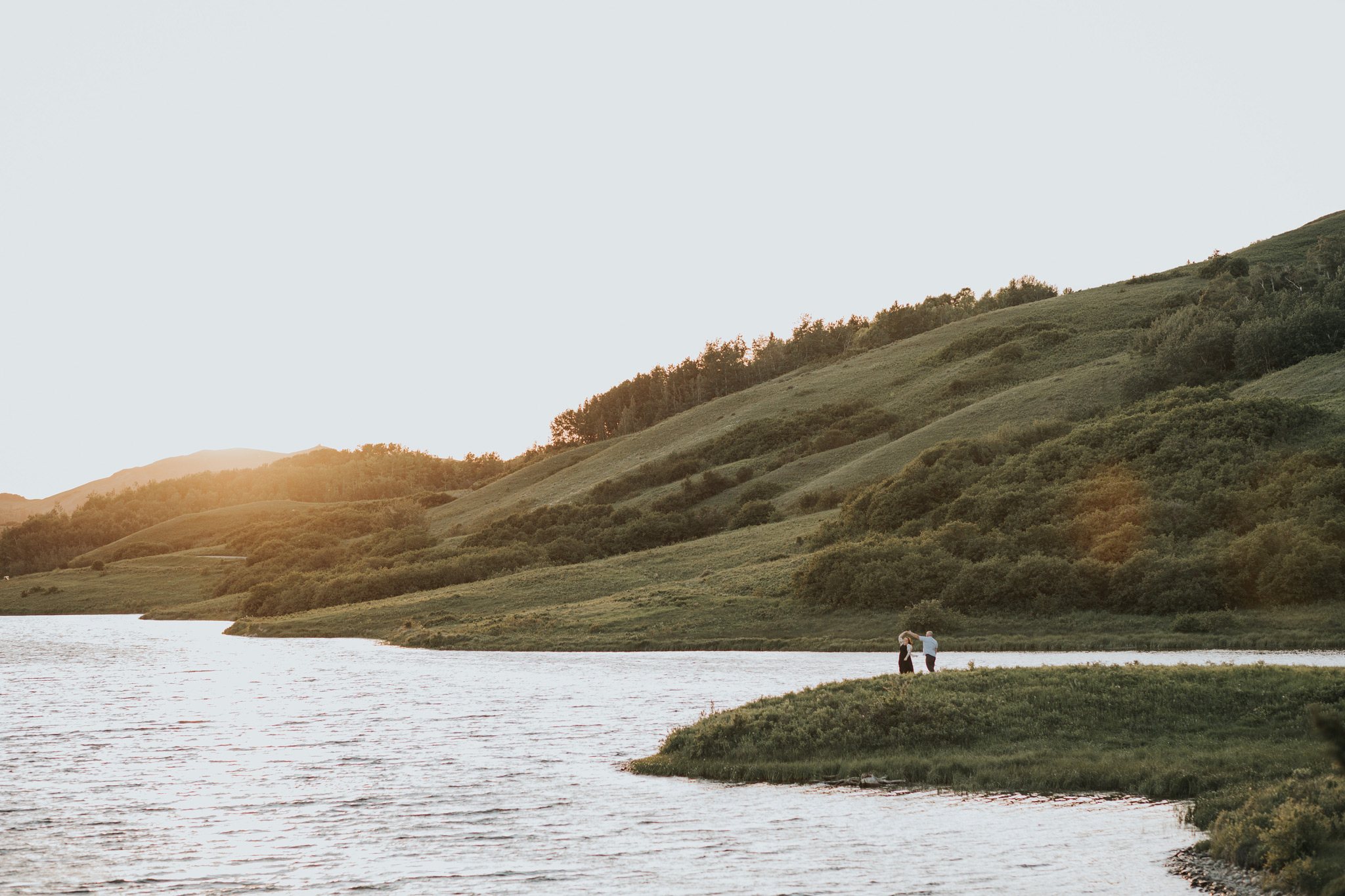 couple dancing by the lake at sunset cypress hills engagement