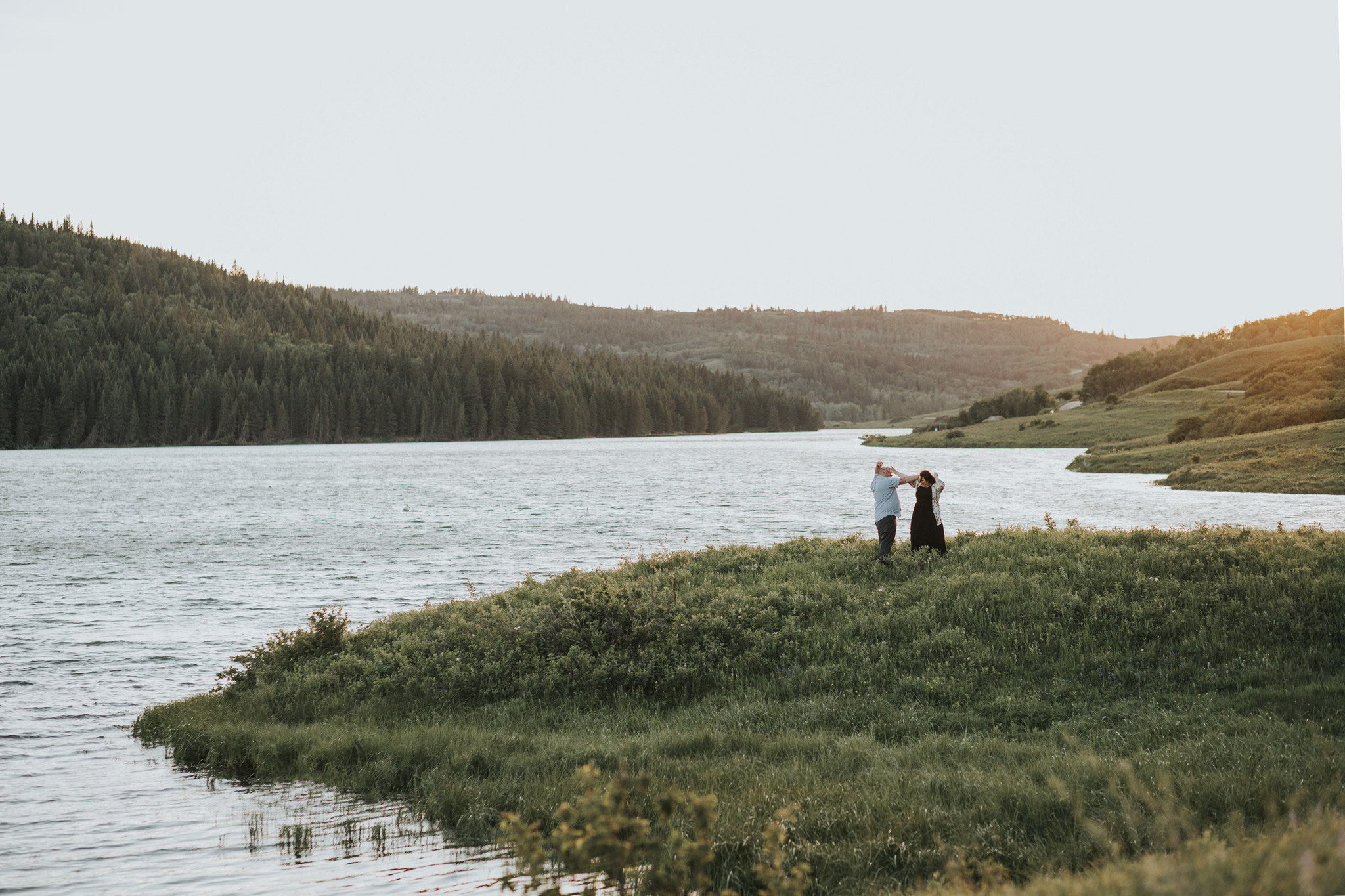 couple dancing by the lake cypress hills engagement photo