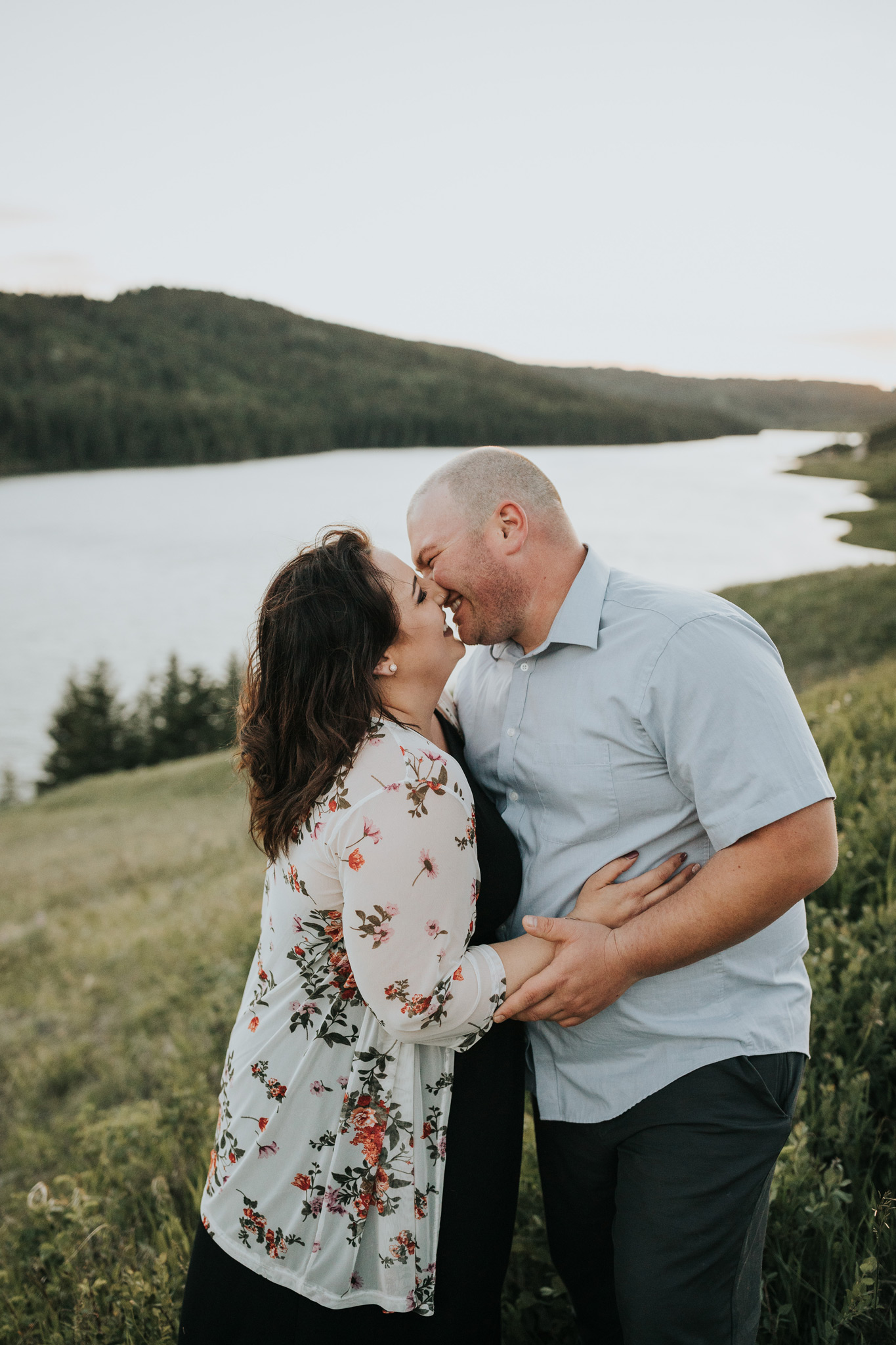 couple about to kiss giggling reesor lake alberta engagement photo