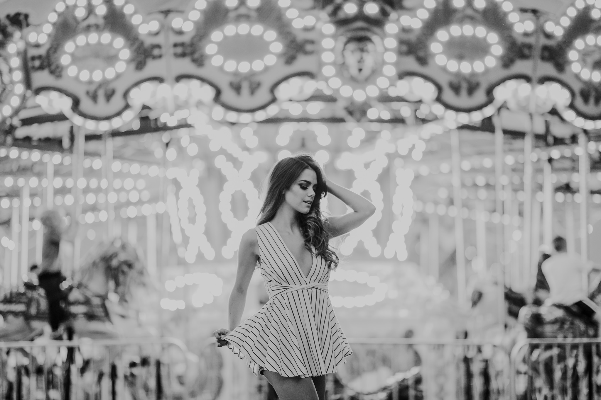model posing in front of carousel lights stampede midway alberta