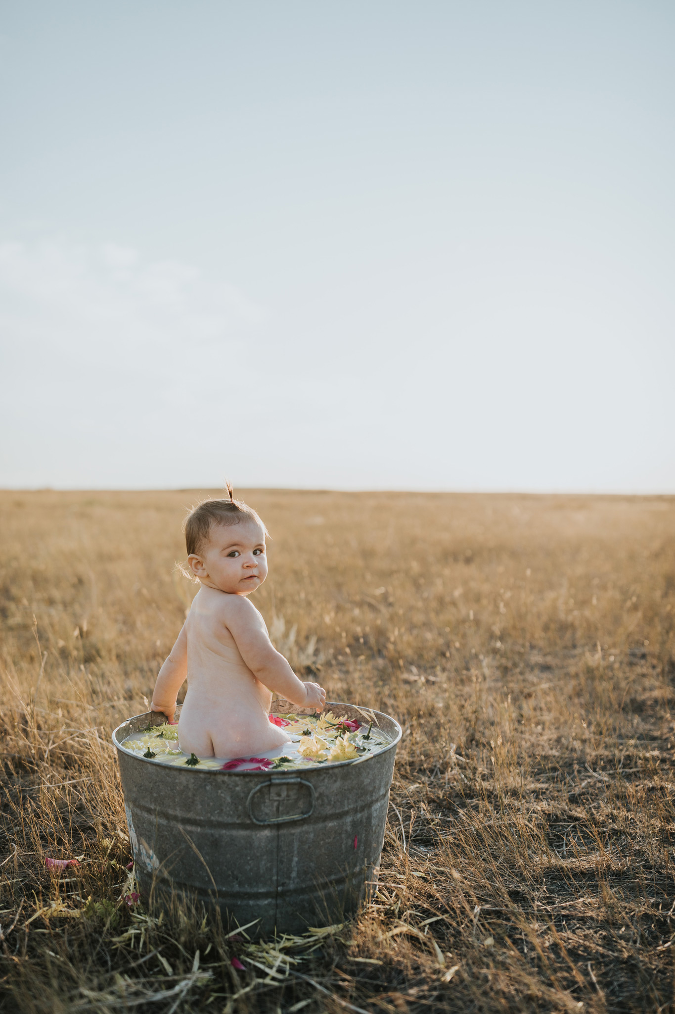 baby standing in flower milk bath alberta
