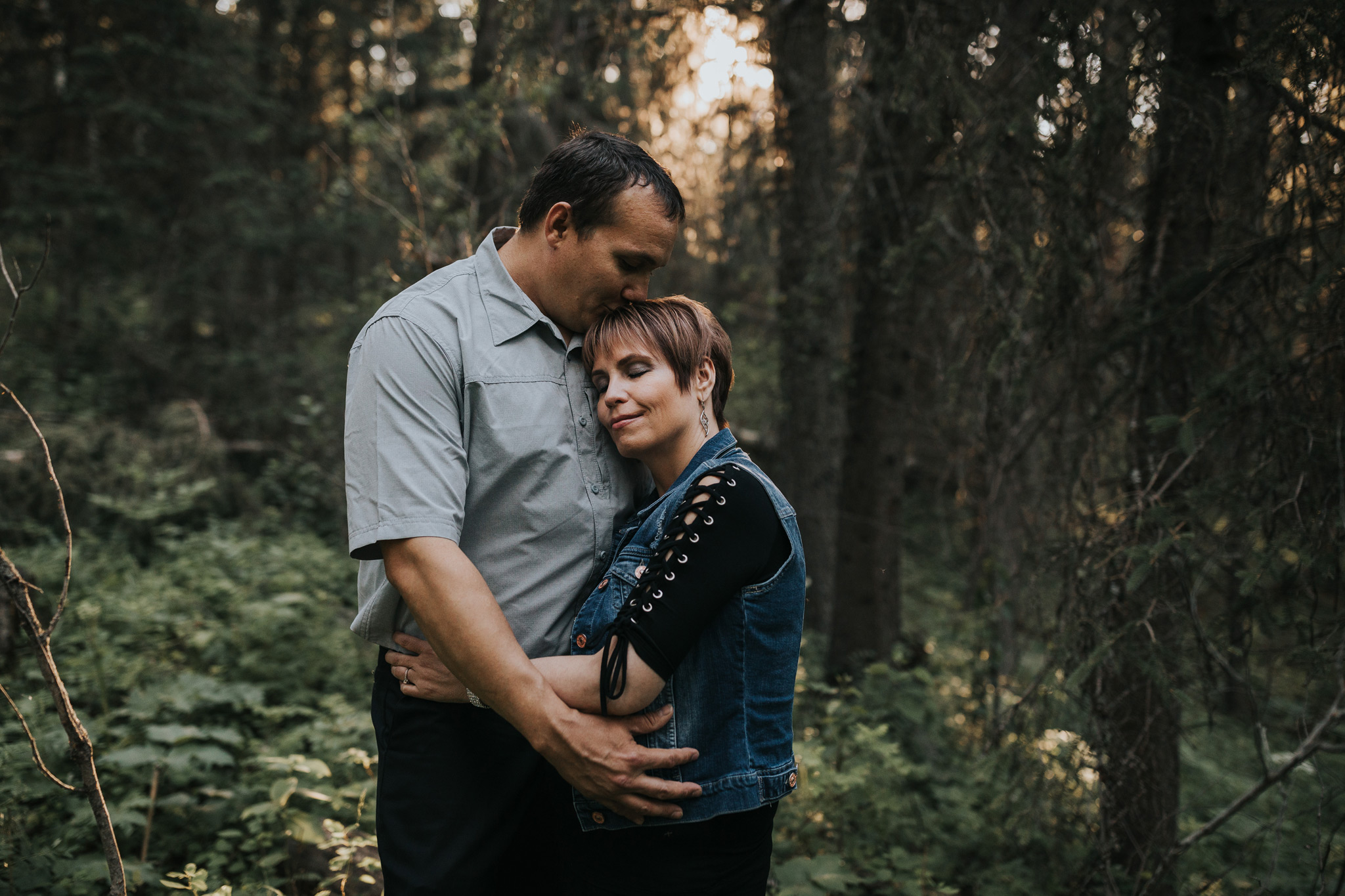 couple embracing in spruce coulee cypress hills engagement