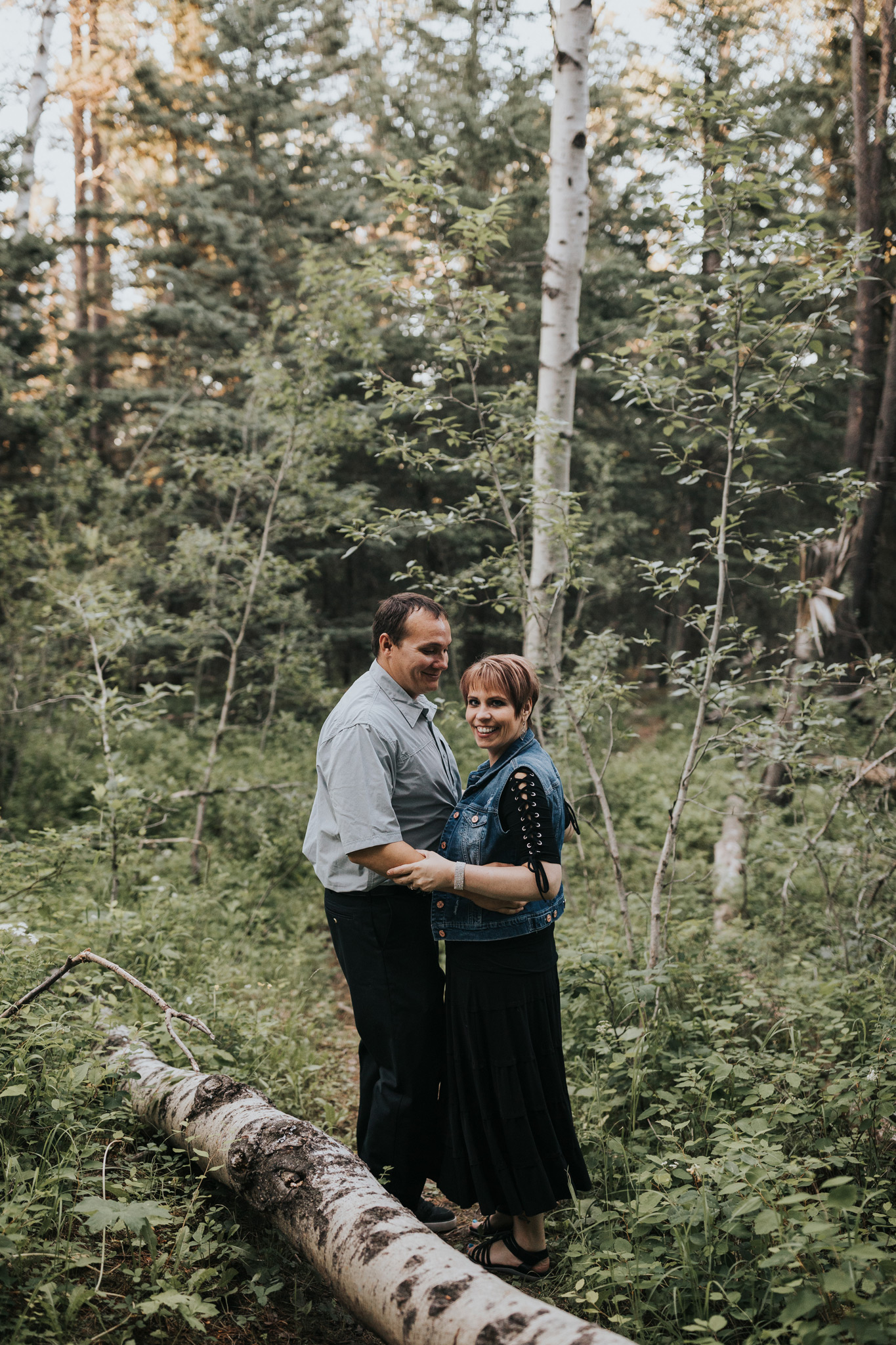 couple standing smiling in spruce coulee campground alberta
