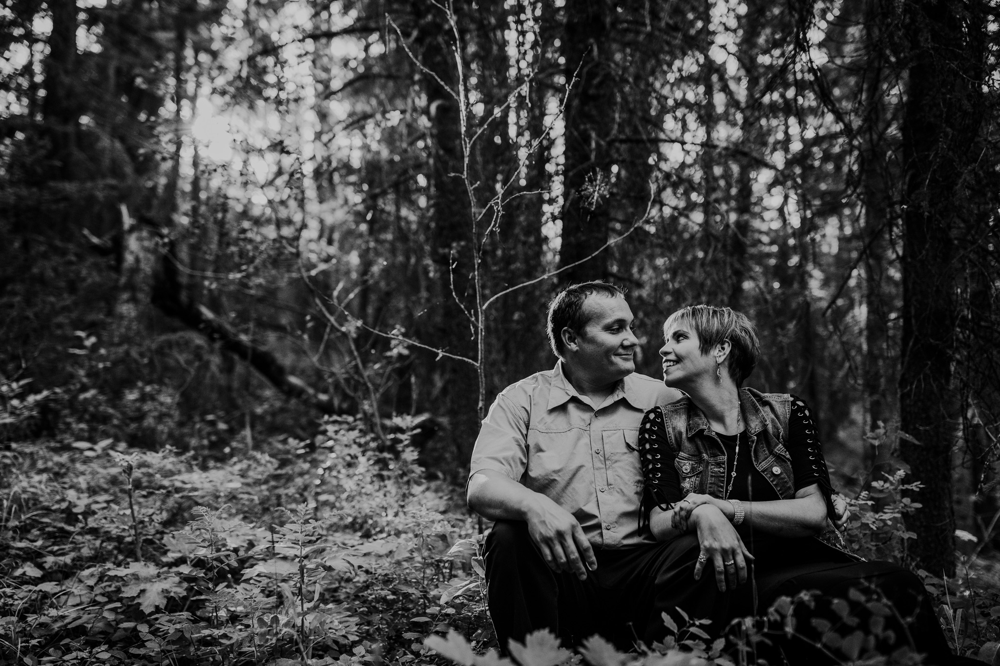 couple sitting on tree log cypress hills engagement