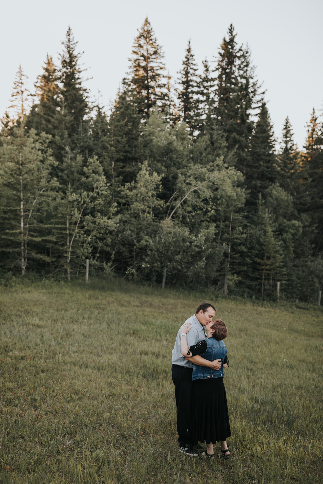 couple kissing at spruce coulee campground alberta engagement
