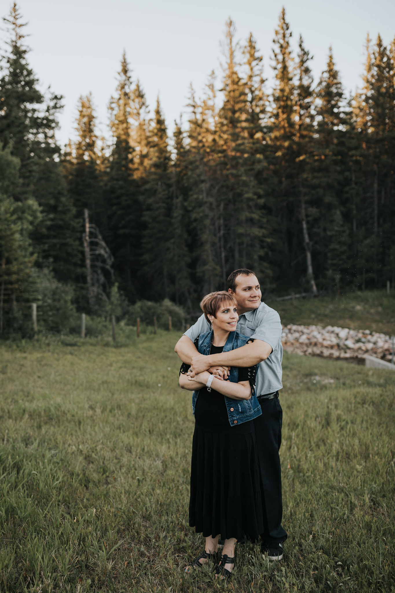 couple embracing spruce coulee engagement photo