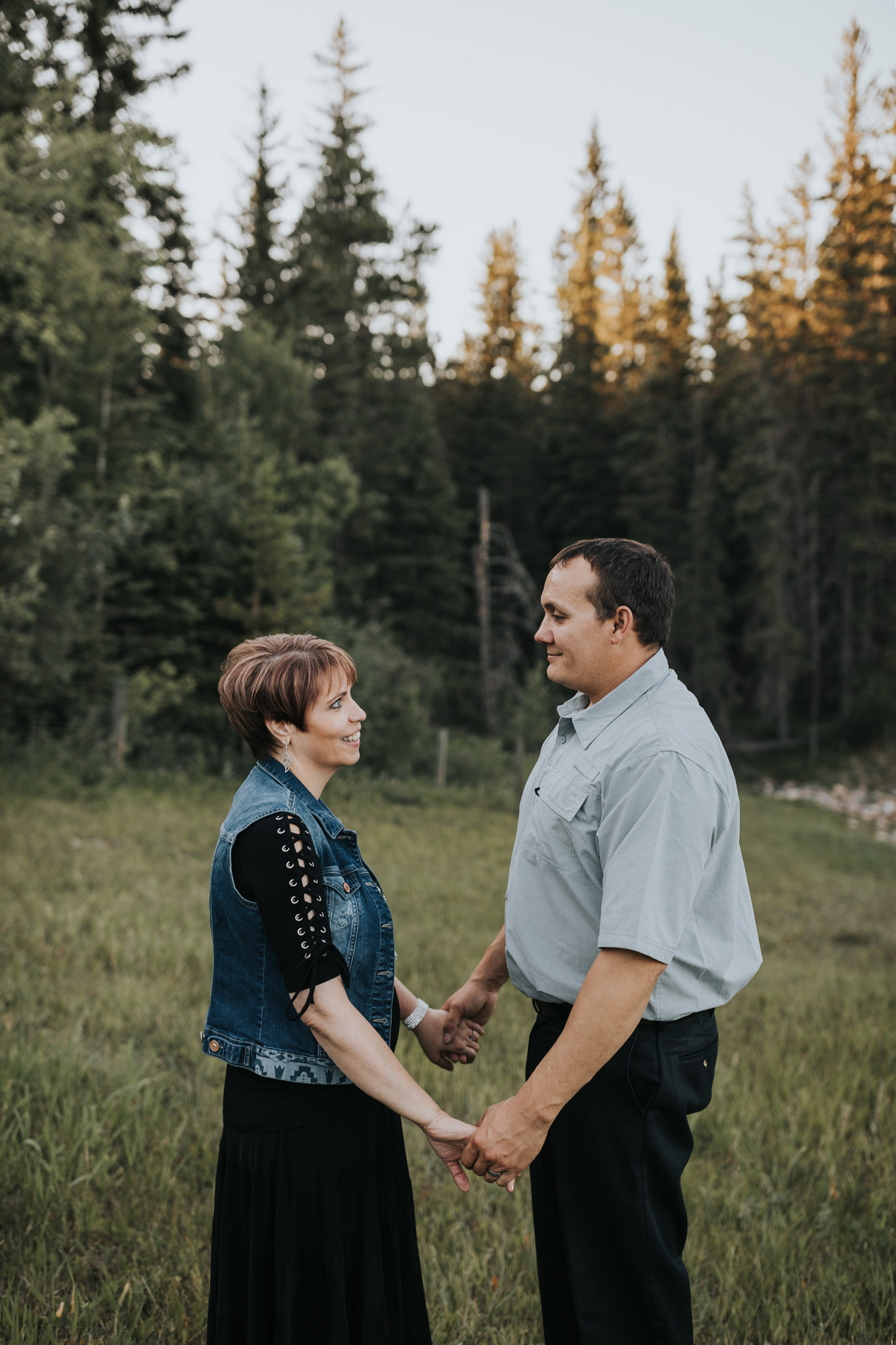 couple holding hands smiling cypress hills alberta engagement