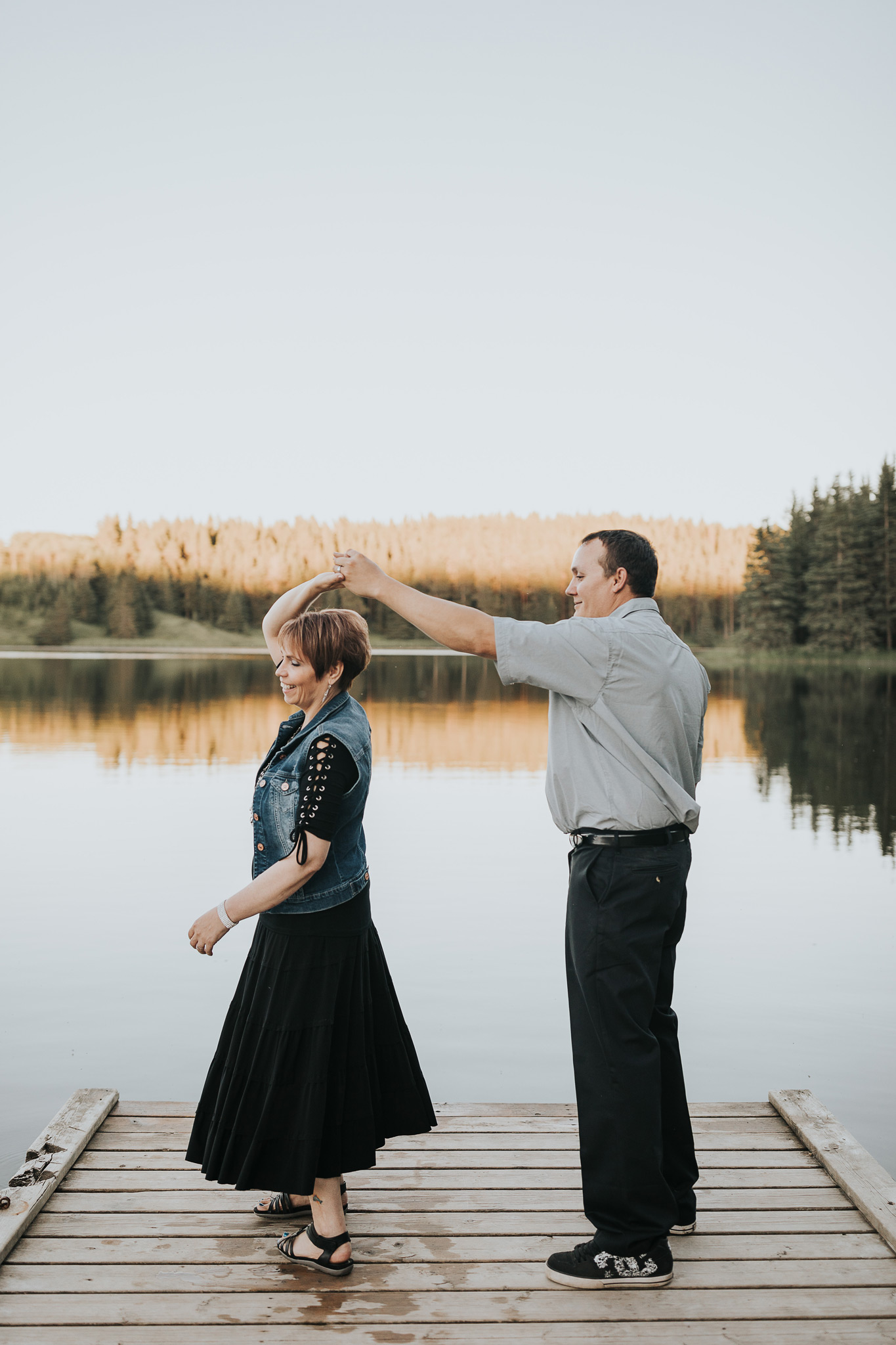 couple dancing on dock spruce coulee campground alberta engagement