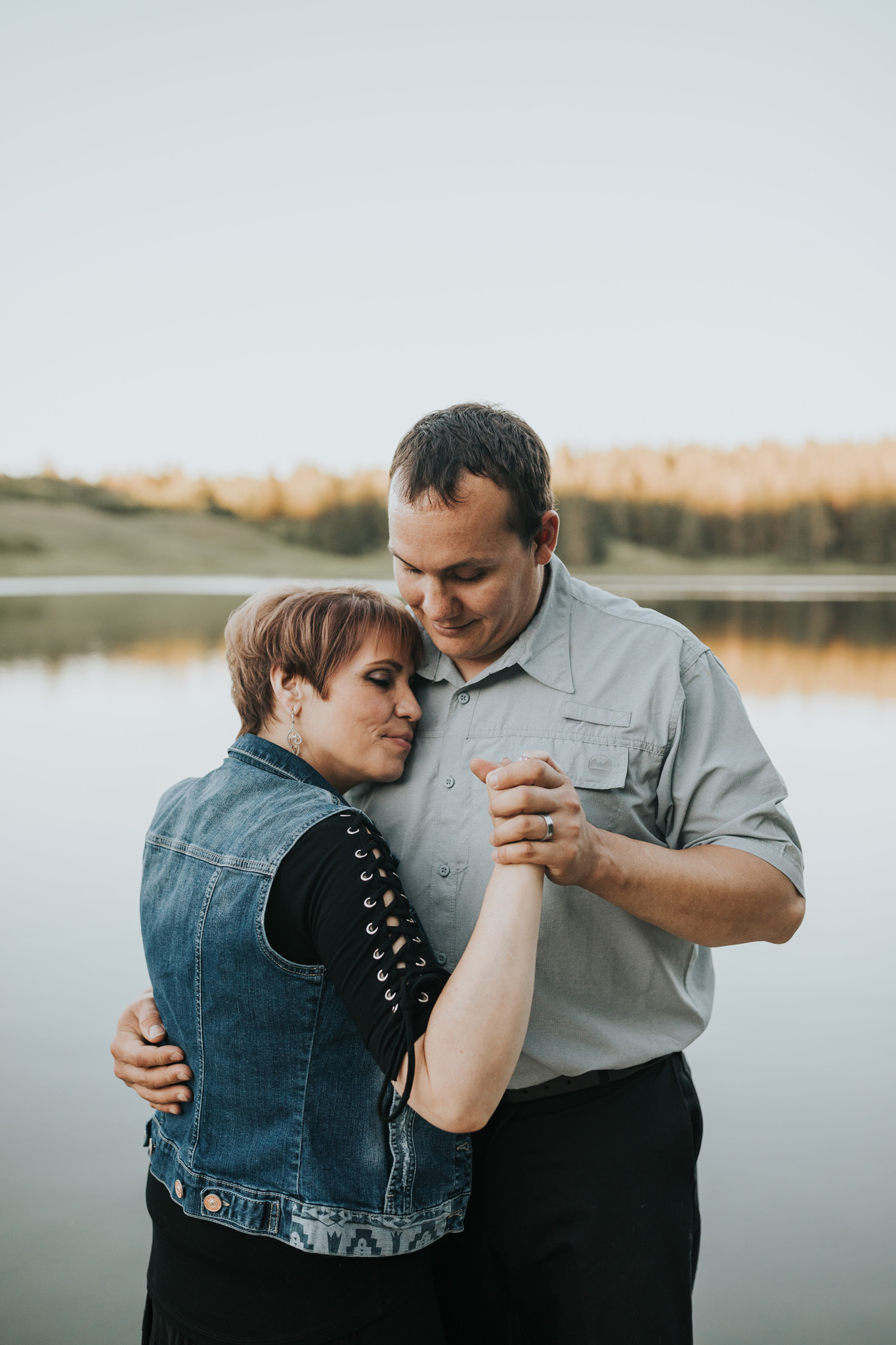 couple dancing close spruce coulee cypress hills engagement photo