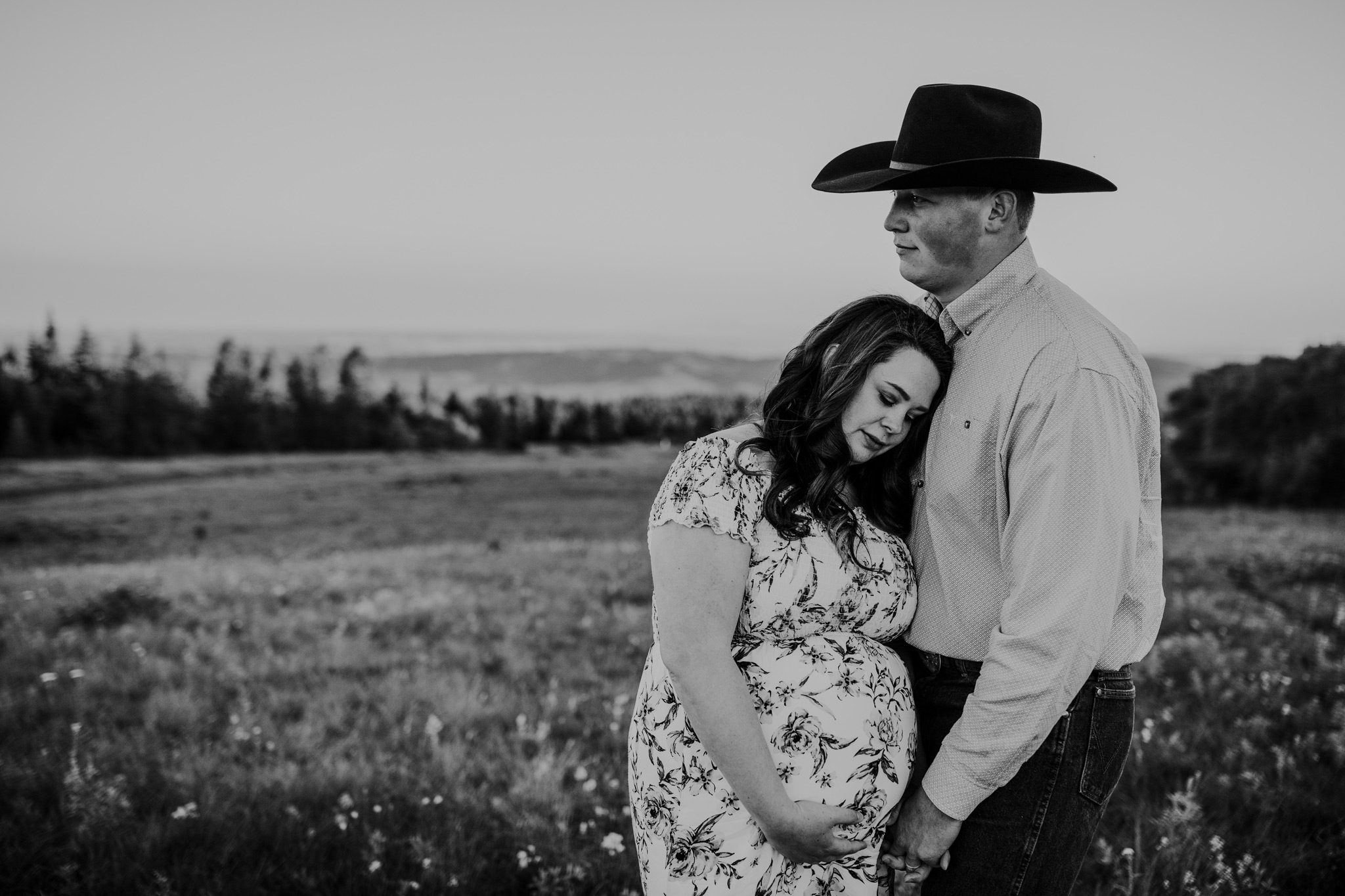 expecting couple embracing at head of the mountain cypress hills maternity