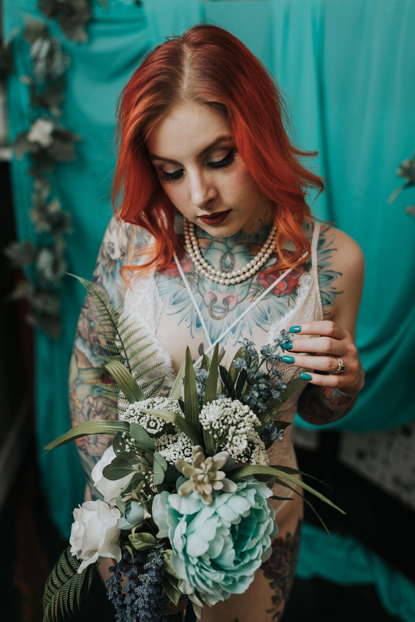 woman holding bridal bouquet medicine hat boudoir photographer