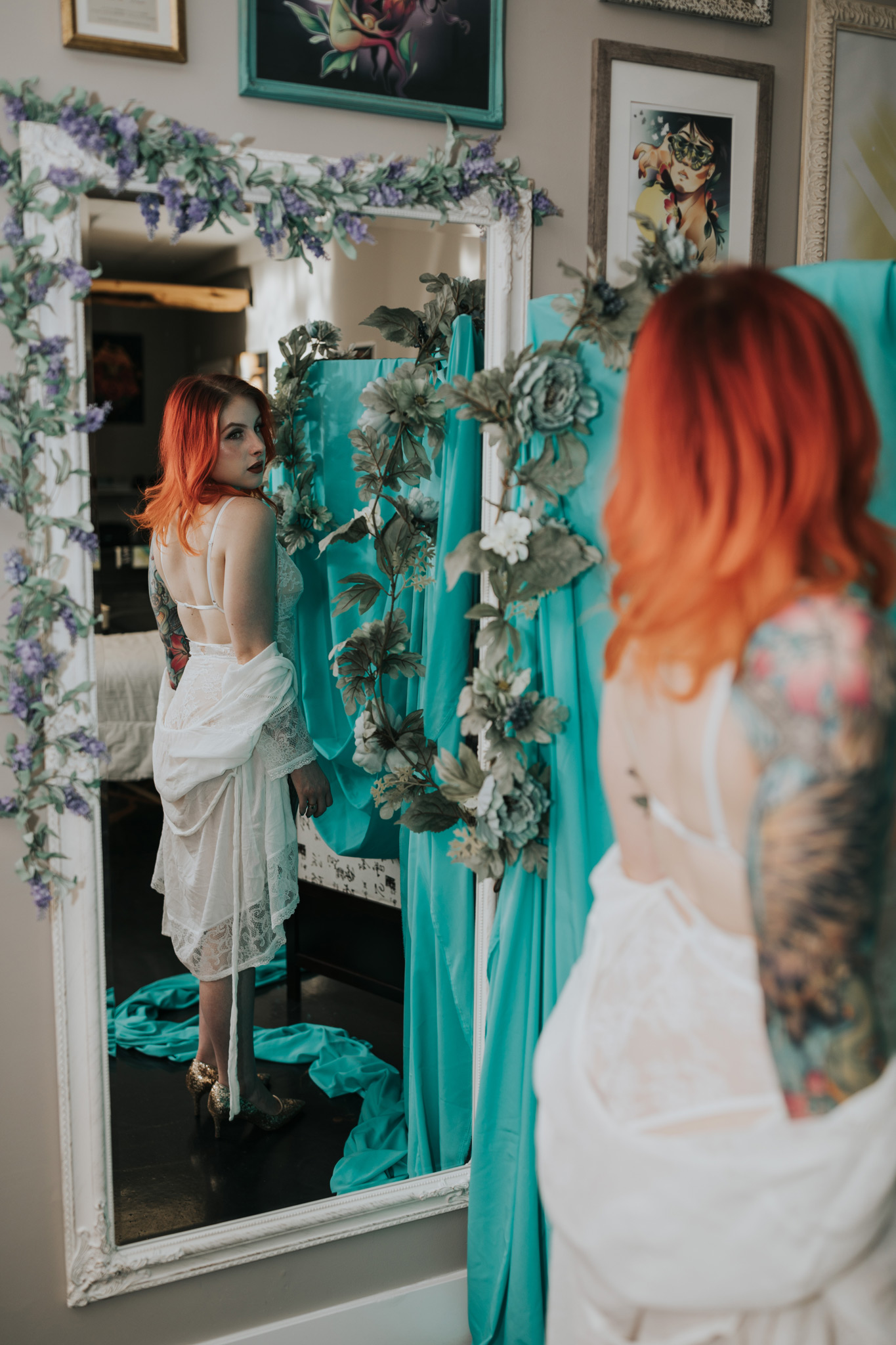 woman standing by mirror reflection bridal boudoir