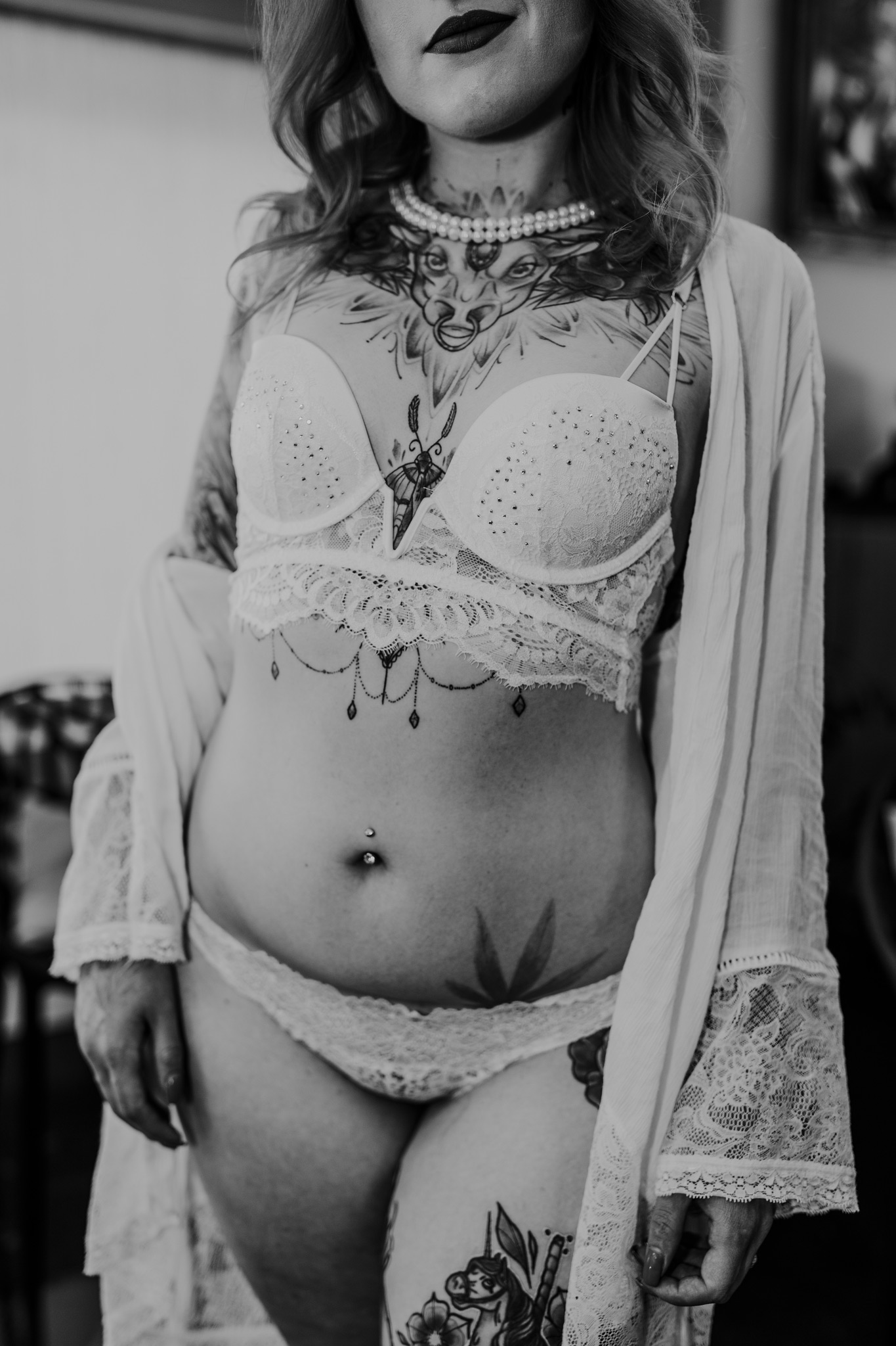 closeup tattooed woman standing in lingerie and robe bridal boudoir