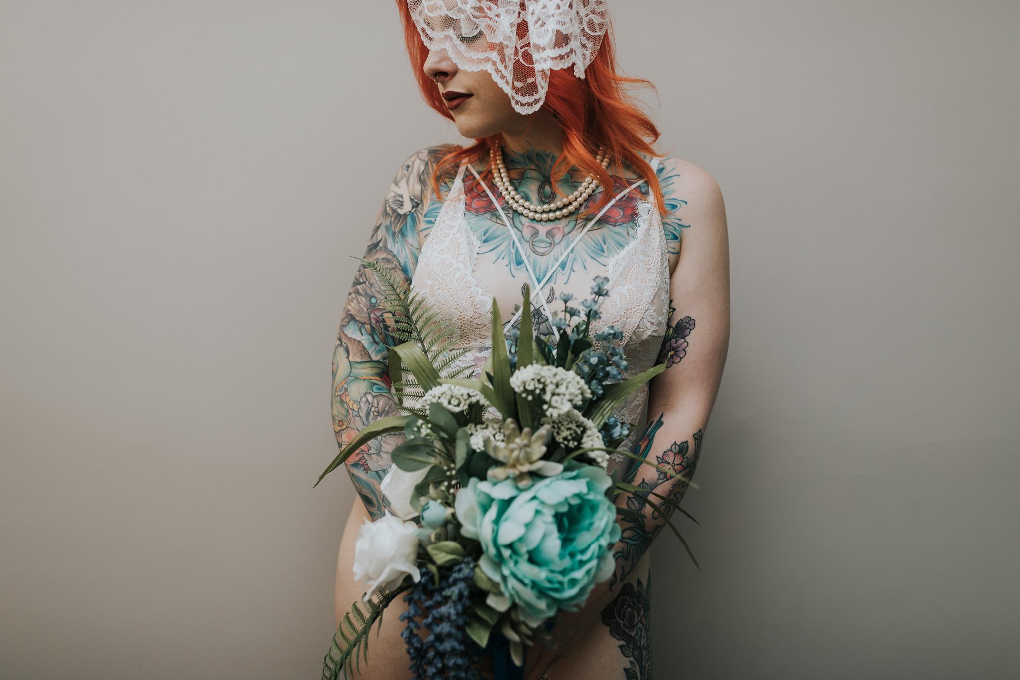 tattooed woman holding bridal bouquet boudoir medicine hat