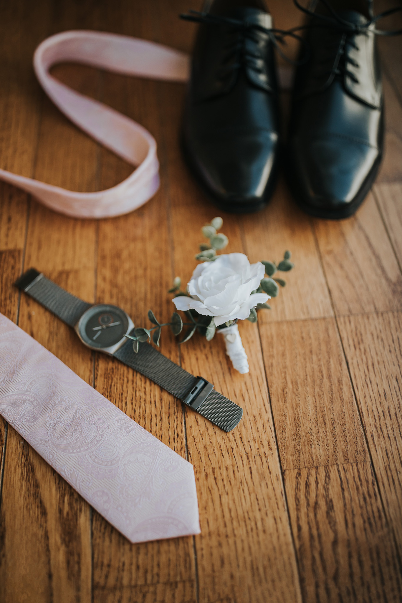 detail photo grooms tie watch boutonniere and shoes