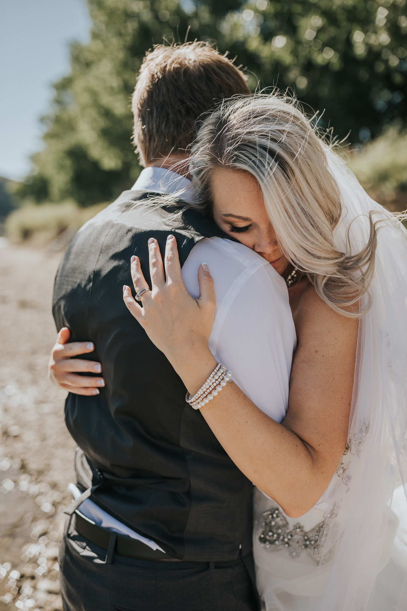 bride and groom embracing medicine hat wedding photographer