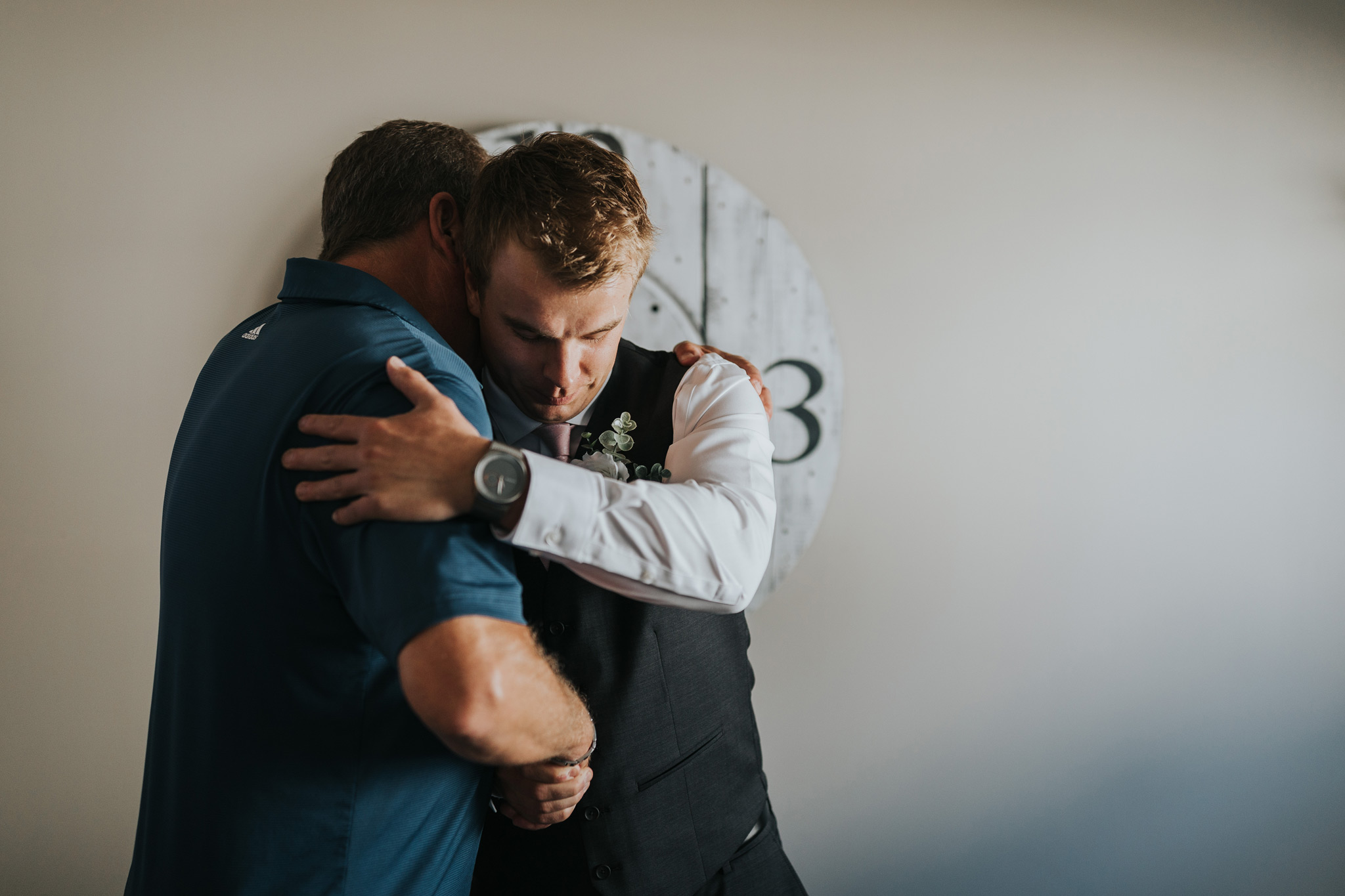 groom hugging his dad before the wedding