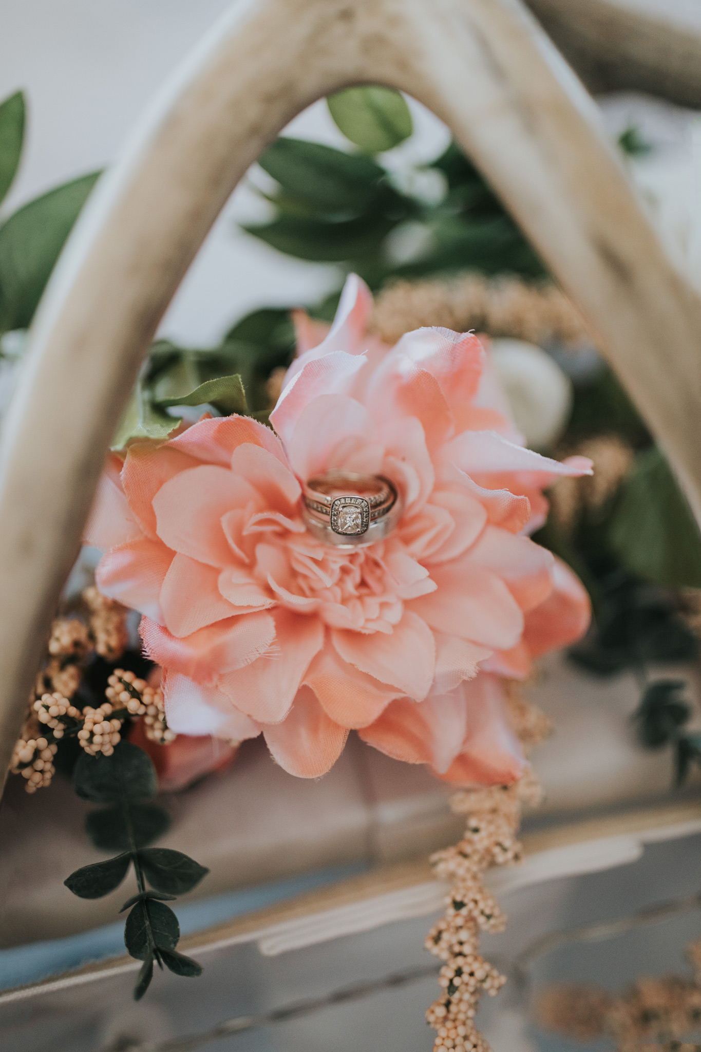 wedding rings in flowers detail photo